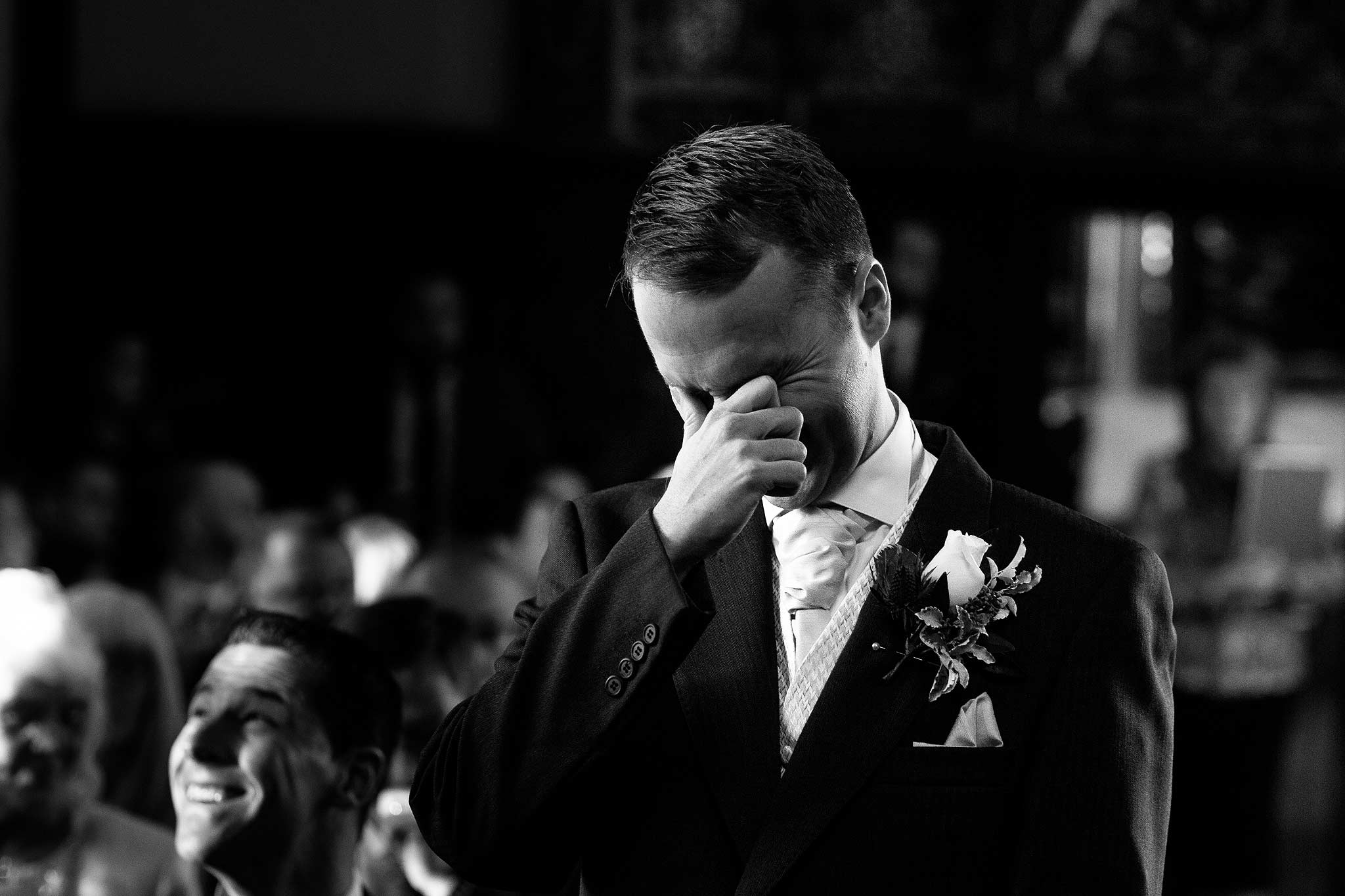 Emotional groom waiting at the top of the aisle at Samlesbury Hall wedding