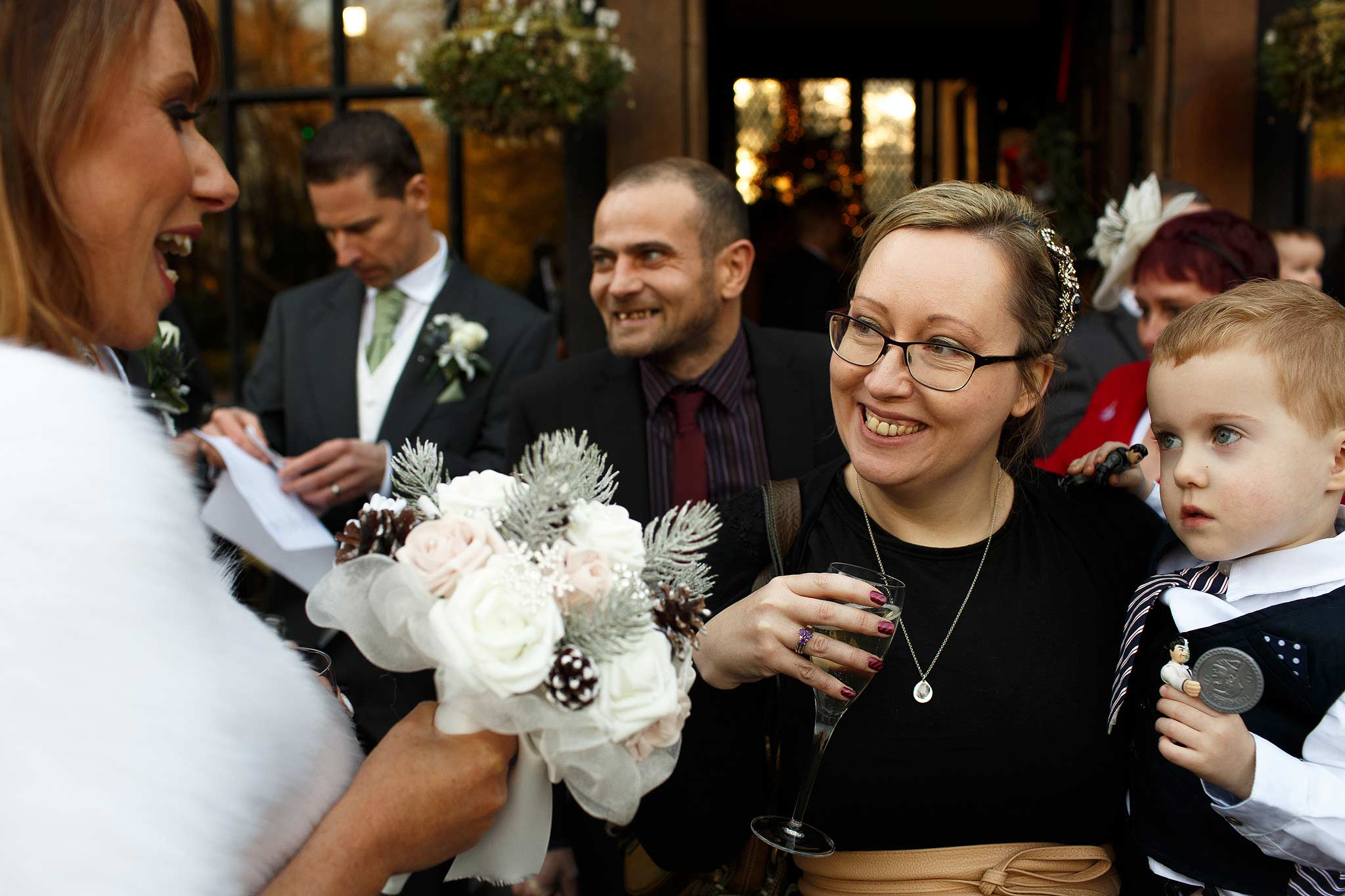 Guests greeting the bride to congratulate her at aSamlesbury Hall