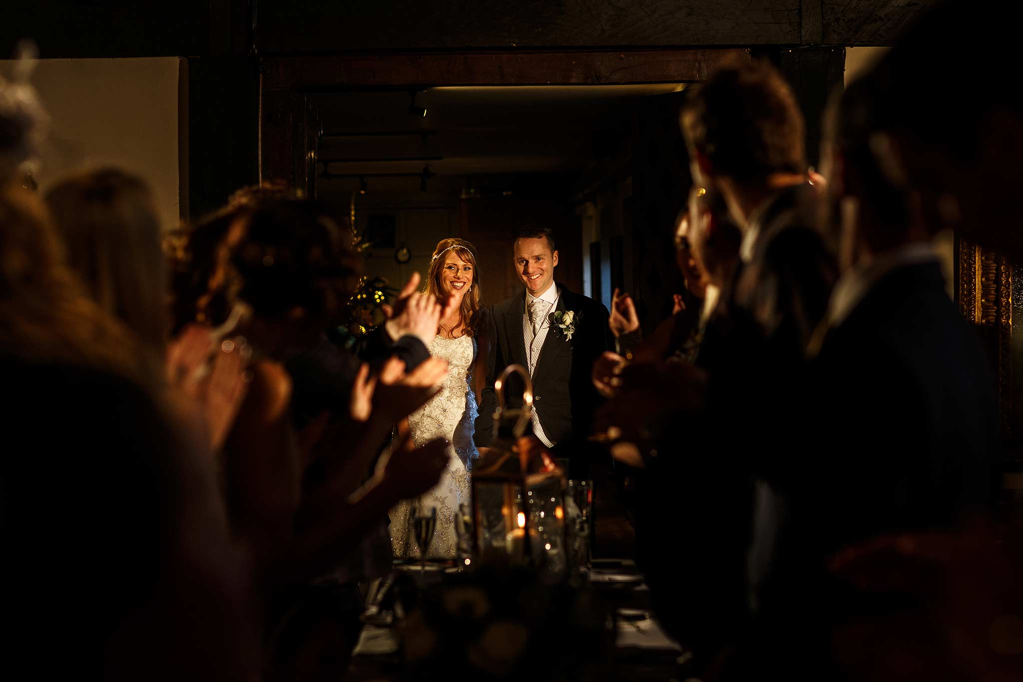 Bride and groom entering the room for their Samlesbury Hall wedding breakfast