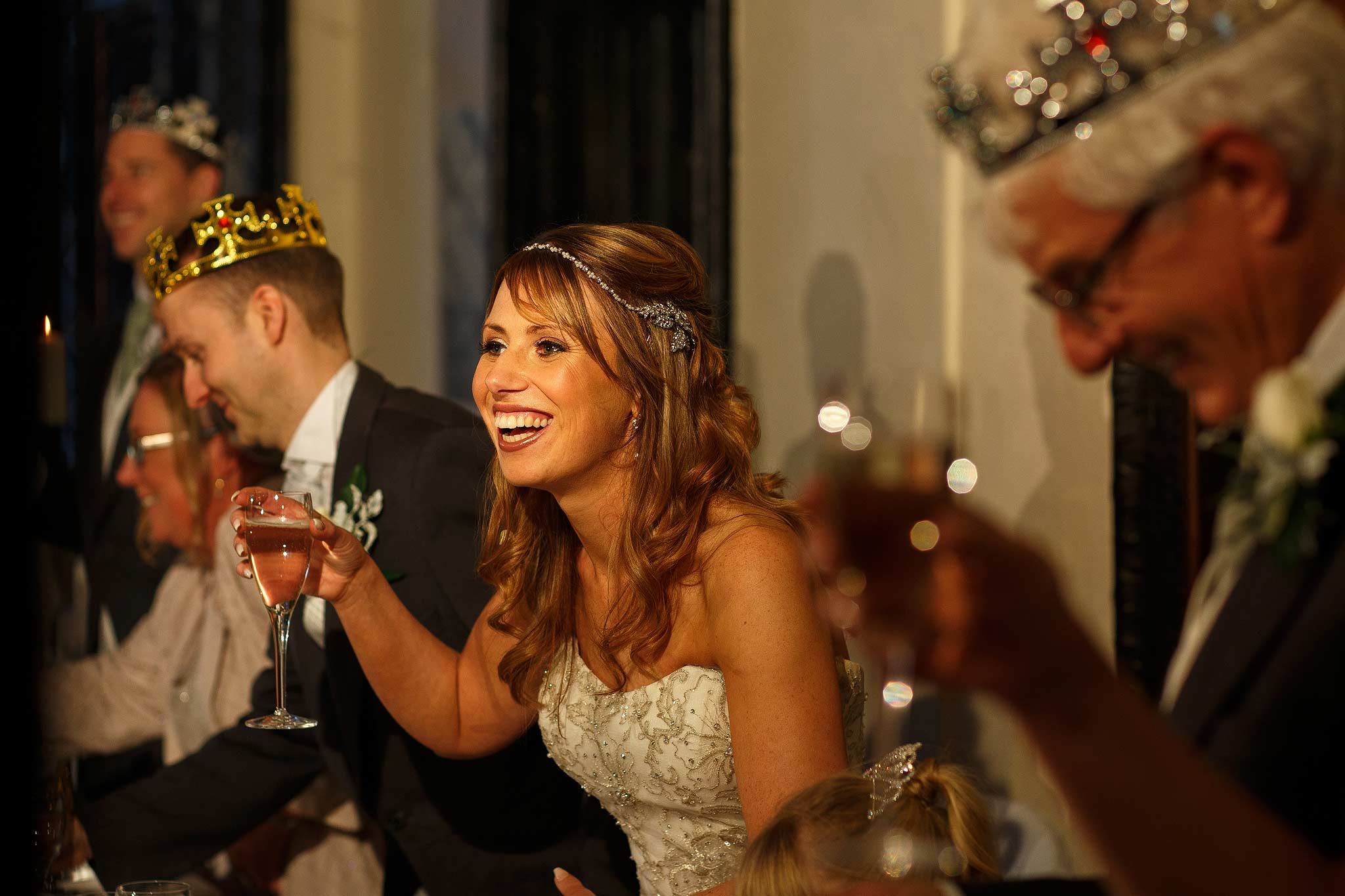 Bride laughing at her fathers speech at Samlesbury Hall wedding