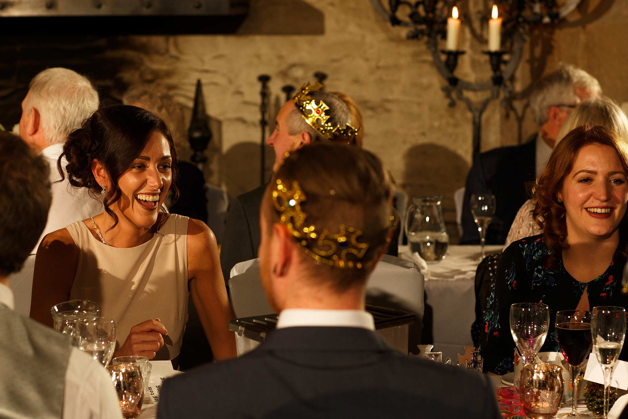 Guests laughing during the speeches at Samlesbury Hall wedding