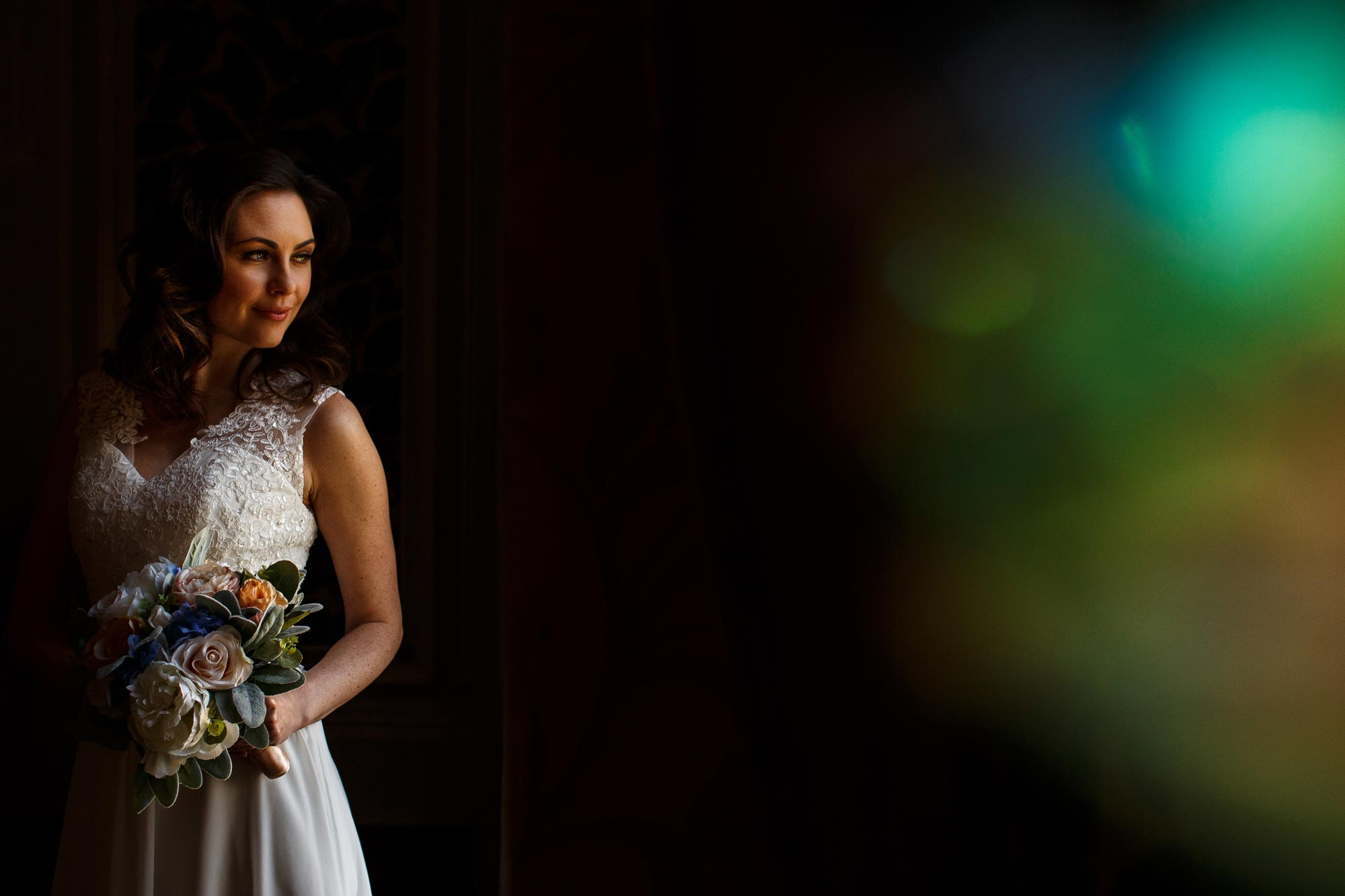 Creative wedding photograph of bride using colour crystals