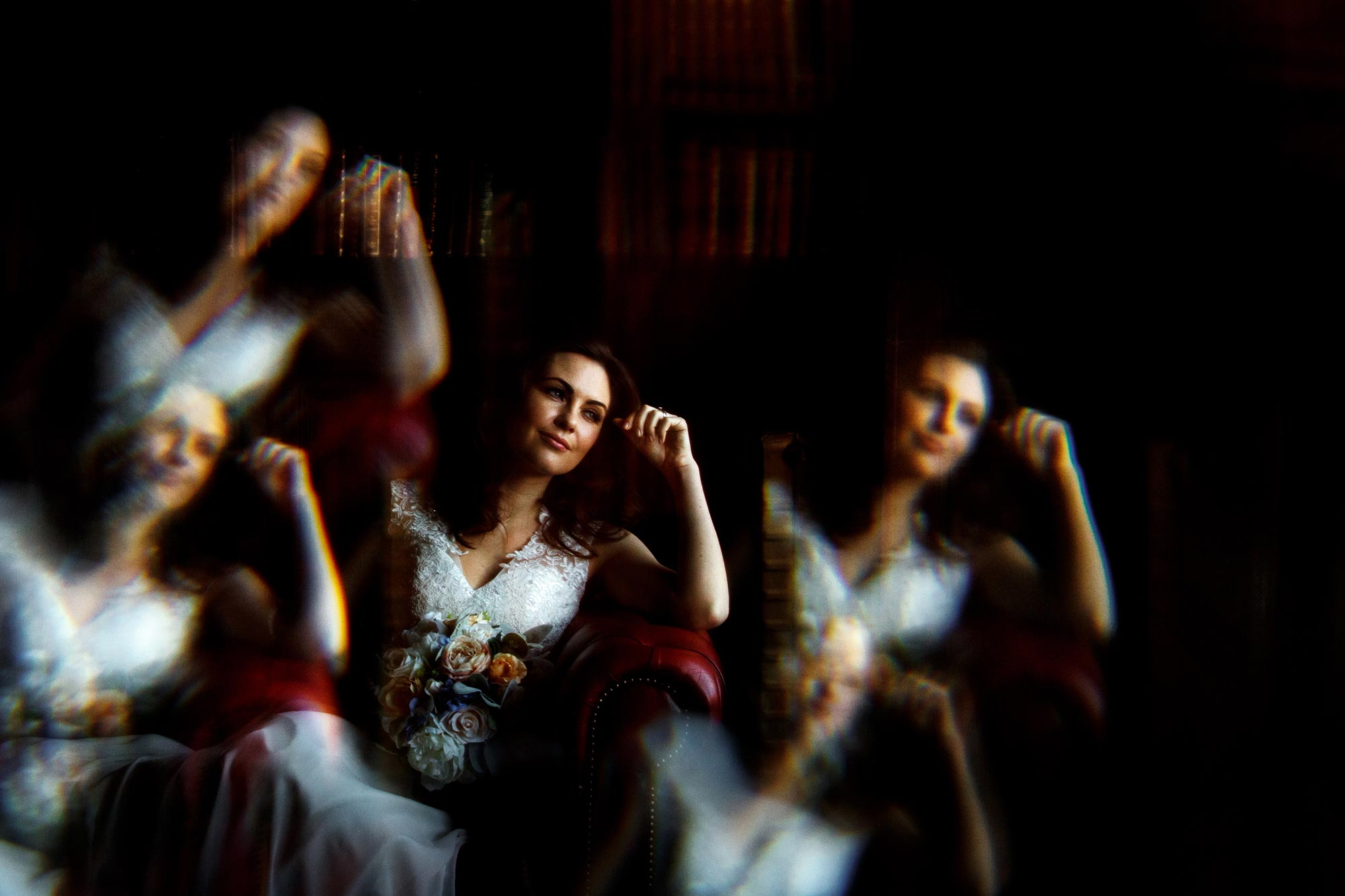 Creative wedding photograph of a bride as if looking through multiple exposures