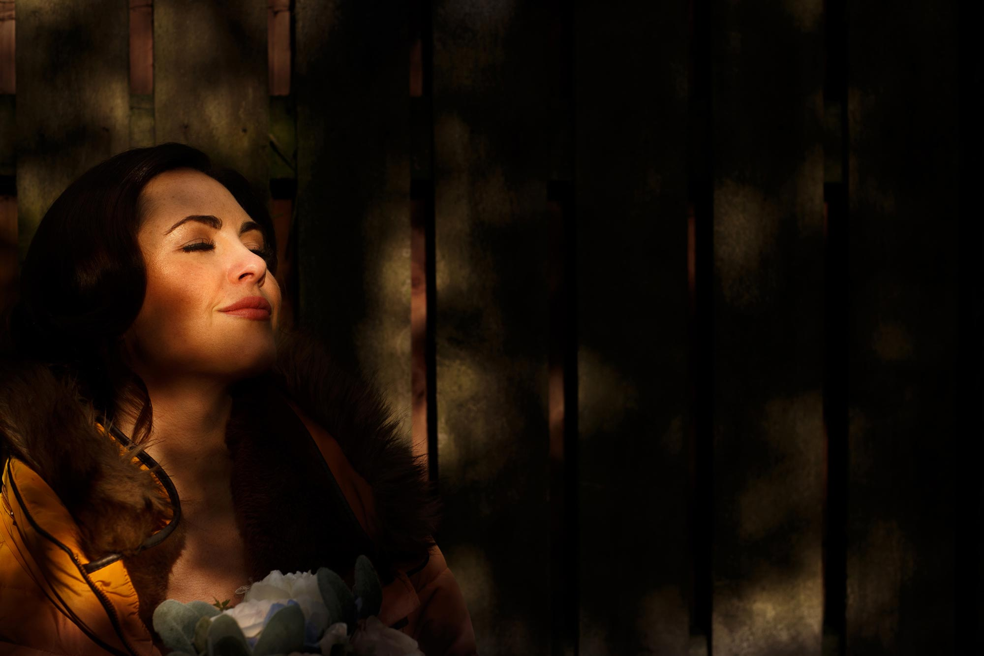 Wedding photograph of bride taken using selective choice of dappled sunlight.