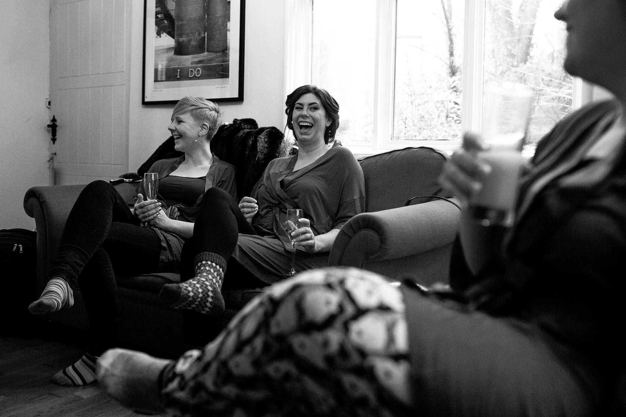Black and white photograph of bridesmaids laughing at Samlesbury Hall Wedding