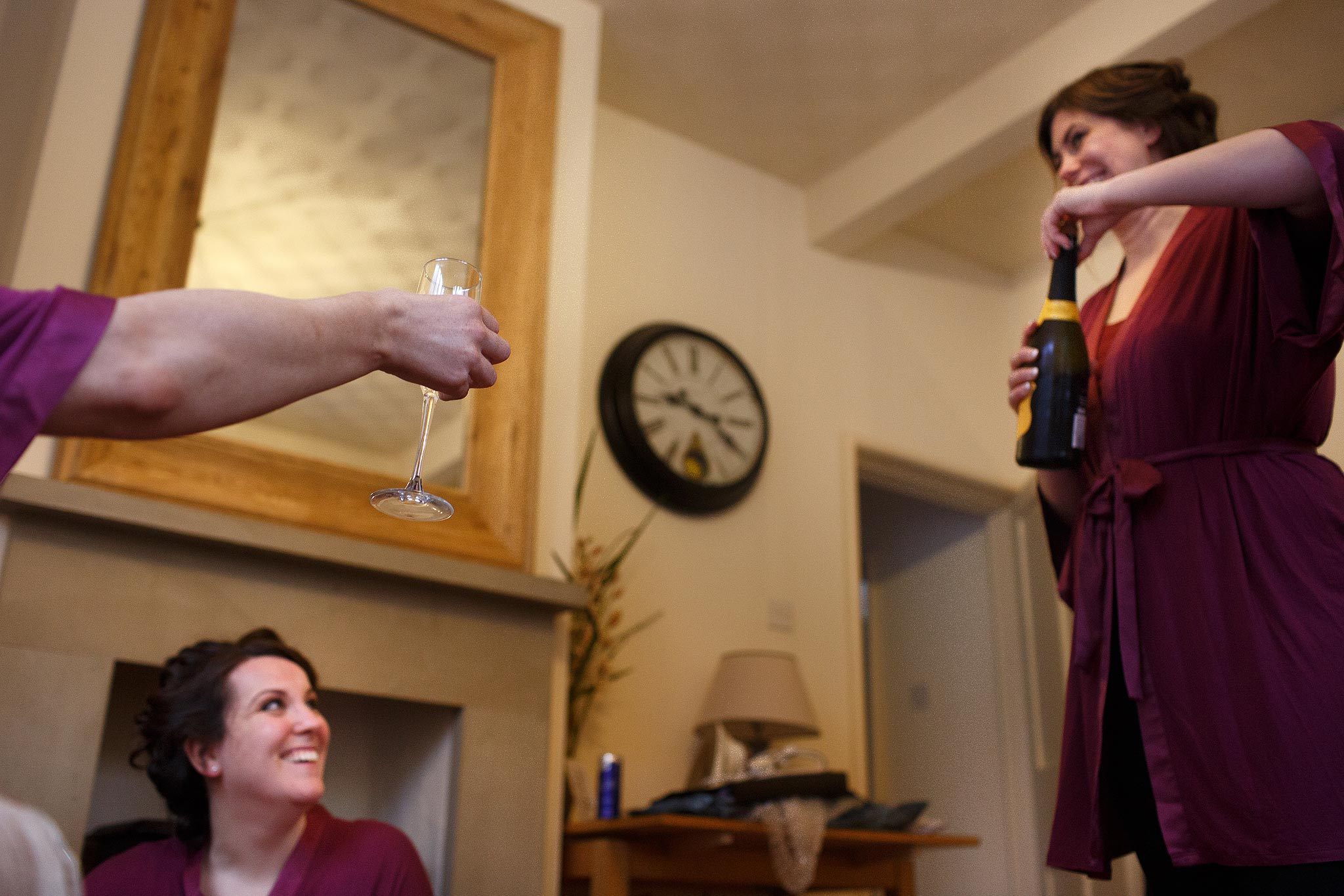 Bridesmaids pouring champagne in the Lodge at Samlesbury Hall Wedding