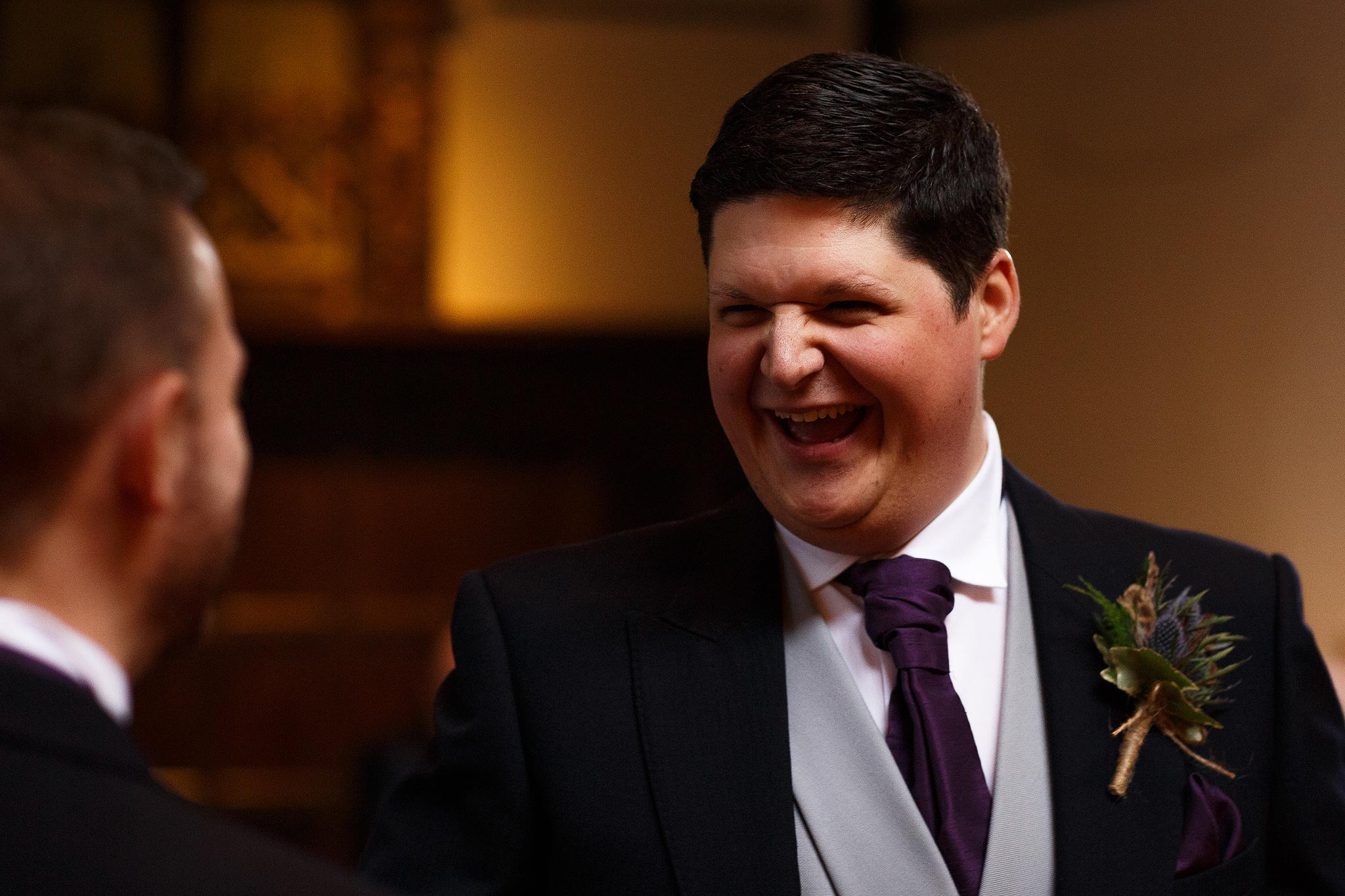 Groom laughing at the top of the aisle at Samlesbury Hall Wedding