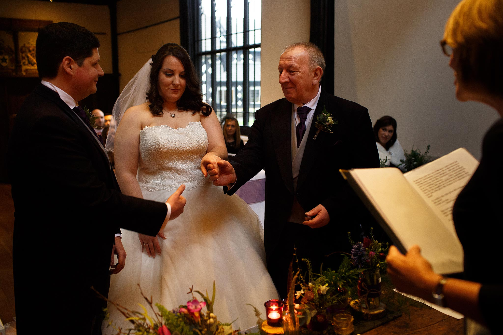 Dad passing his daughters hand to groom at Samlesbury Hall Wedding