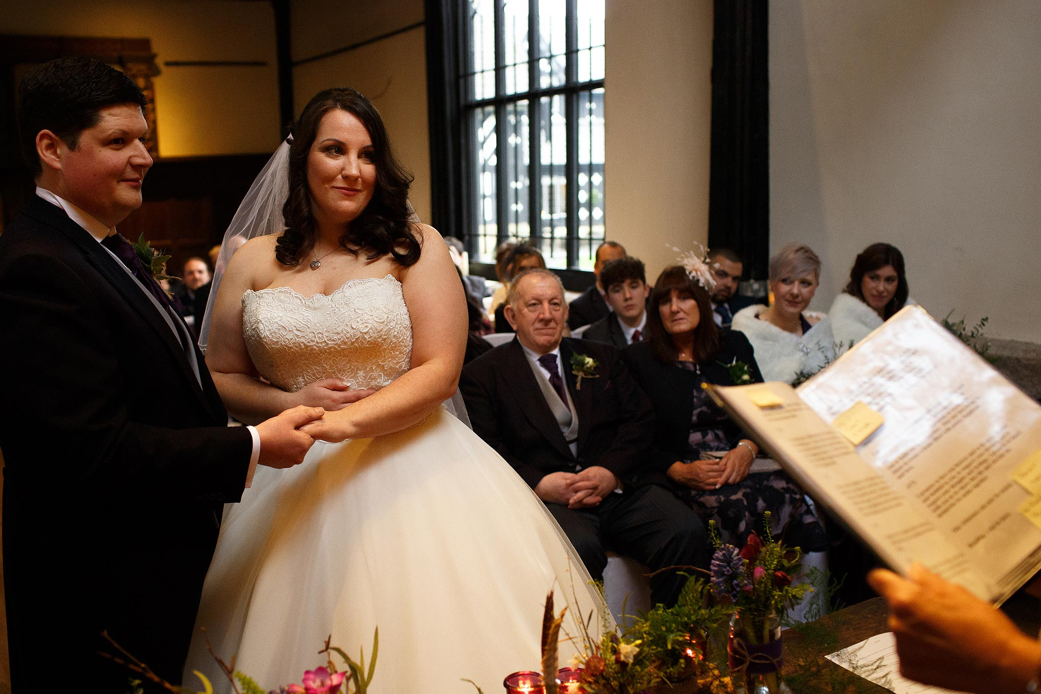 Bride and groom exchanging vows at Samlesbury Hall Wedding