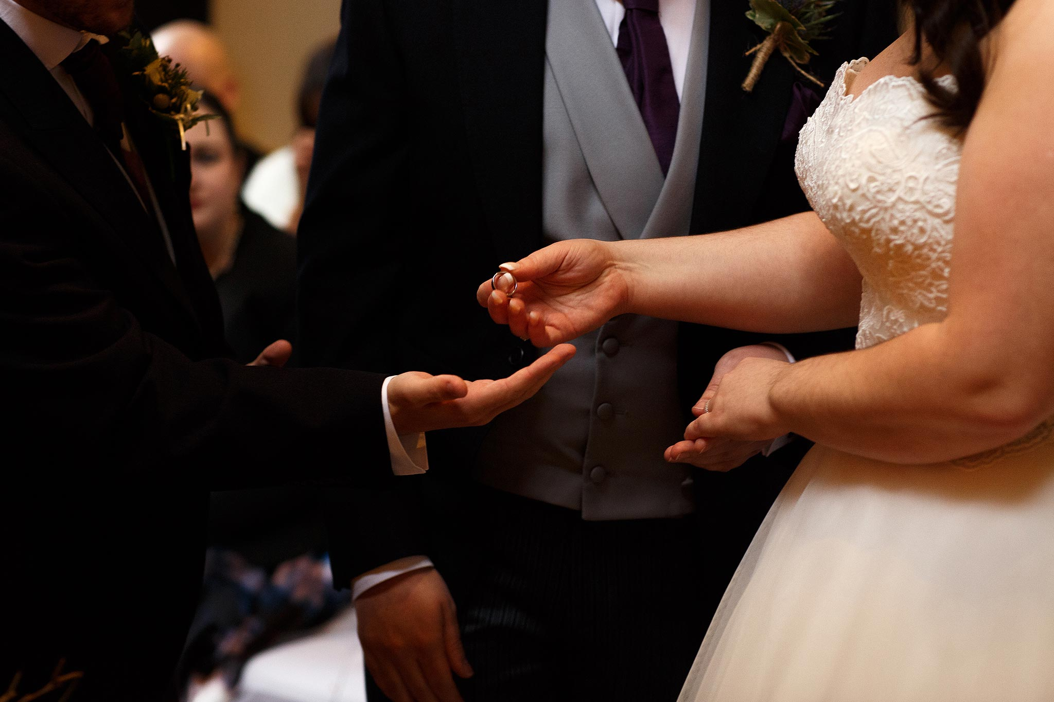 Bride and groom exchanging rings aat Samlesbury Hall Wedding