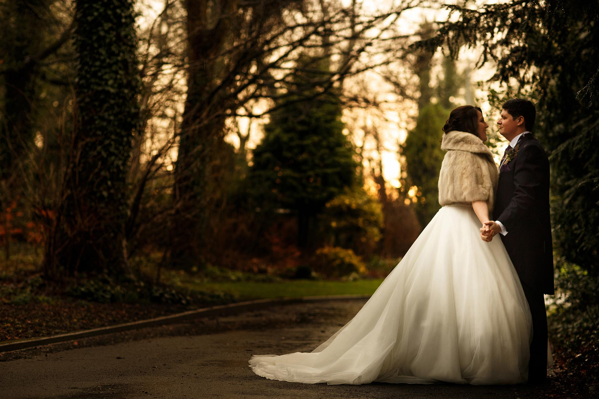 Bride and groom on the driveway of Samlesbury Hall in Winter