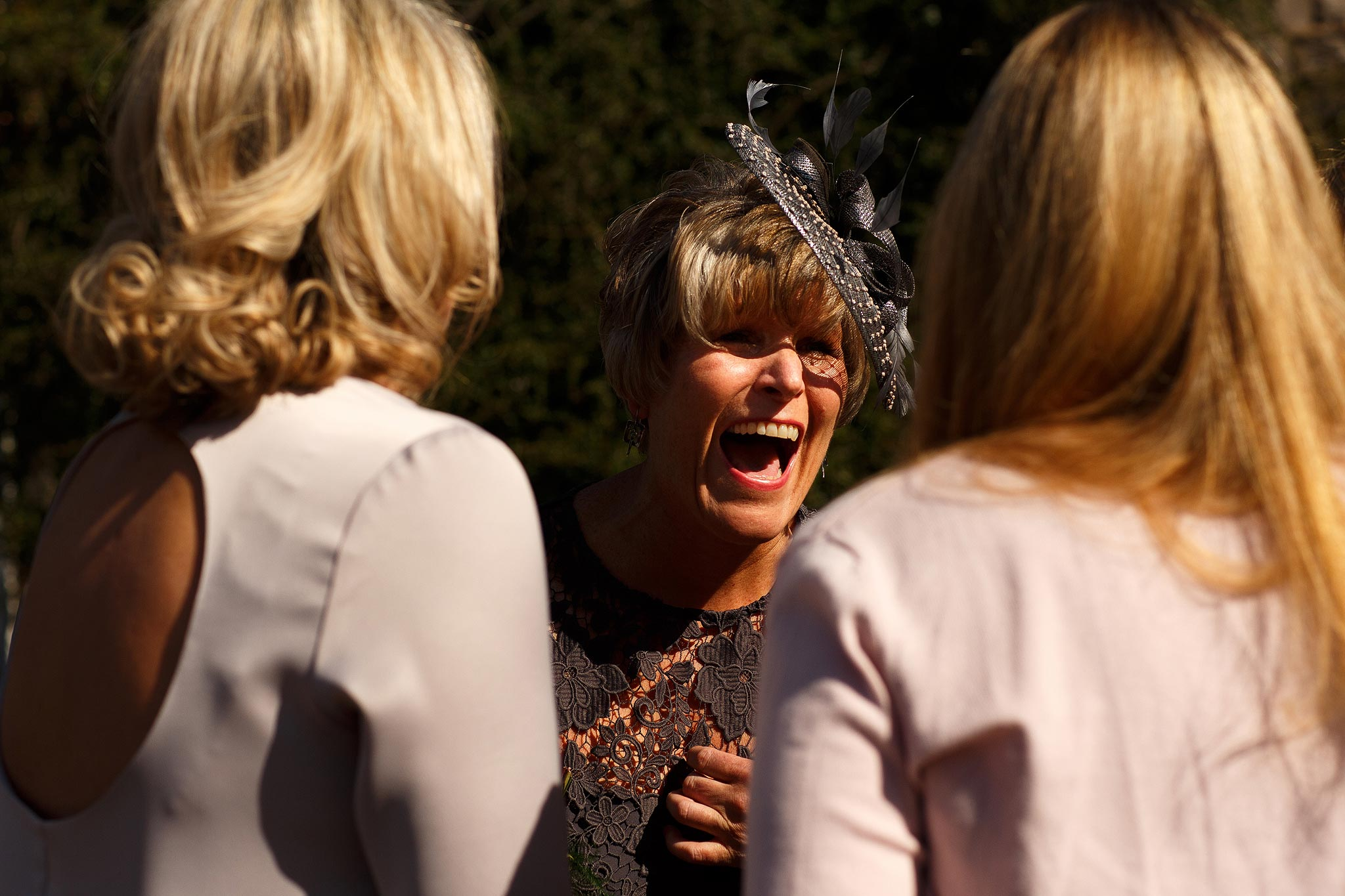 Wedding guests laughing outside the Assheton Arms Downham