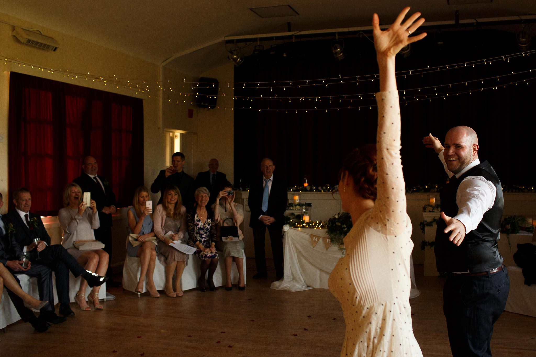 Bride and groom performing a rehearsed first dance at Downham Village Hall wedding
