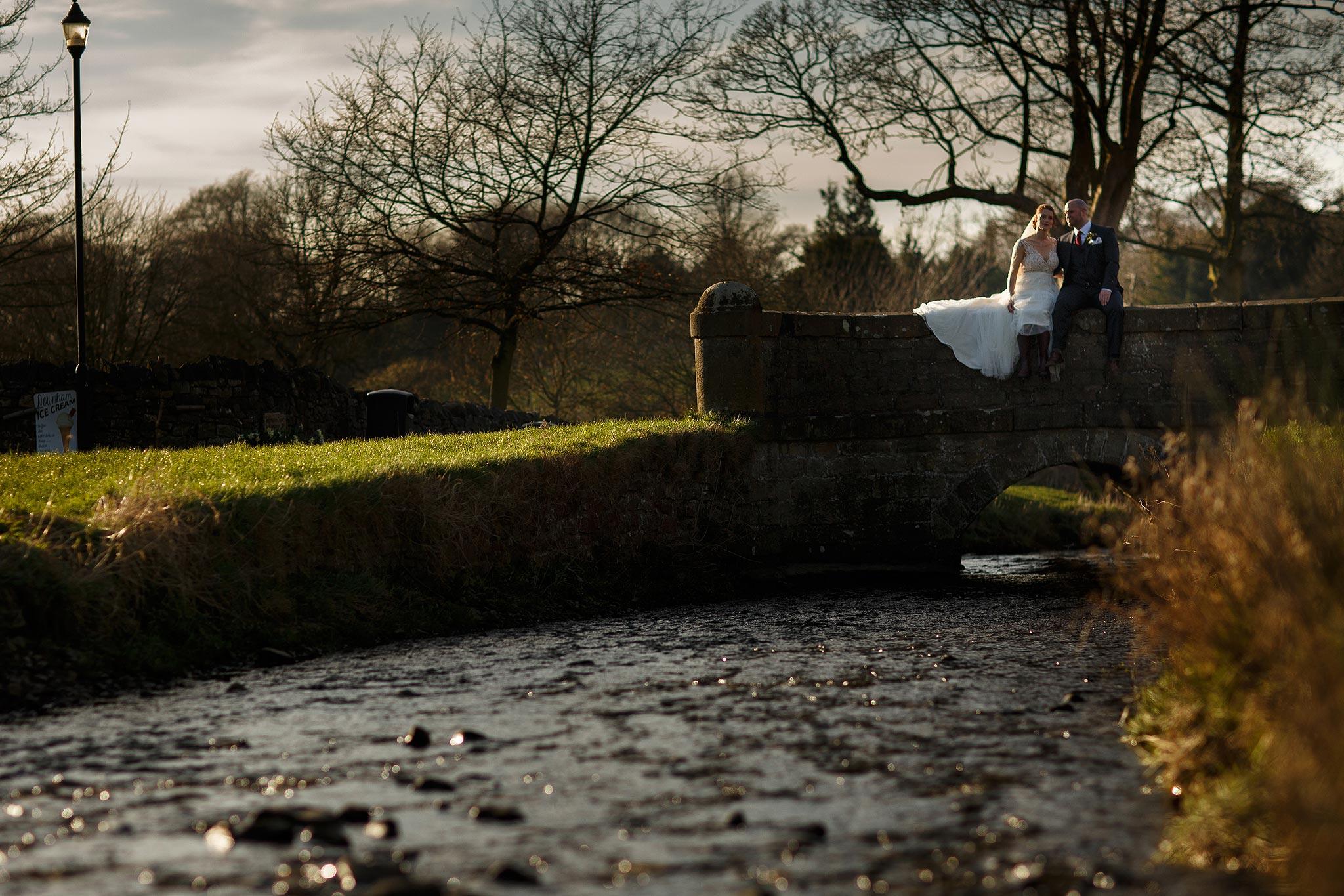 Bride and groom wedding portraits in Downham overlooking the river