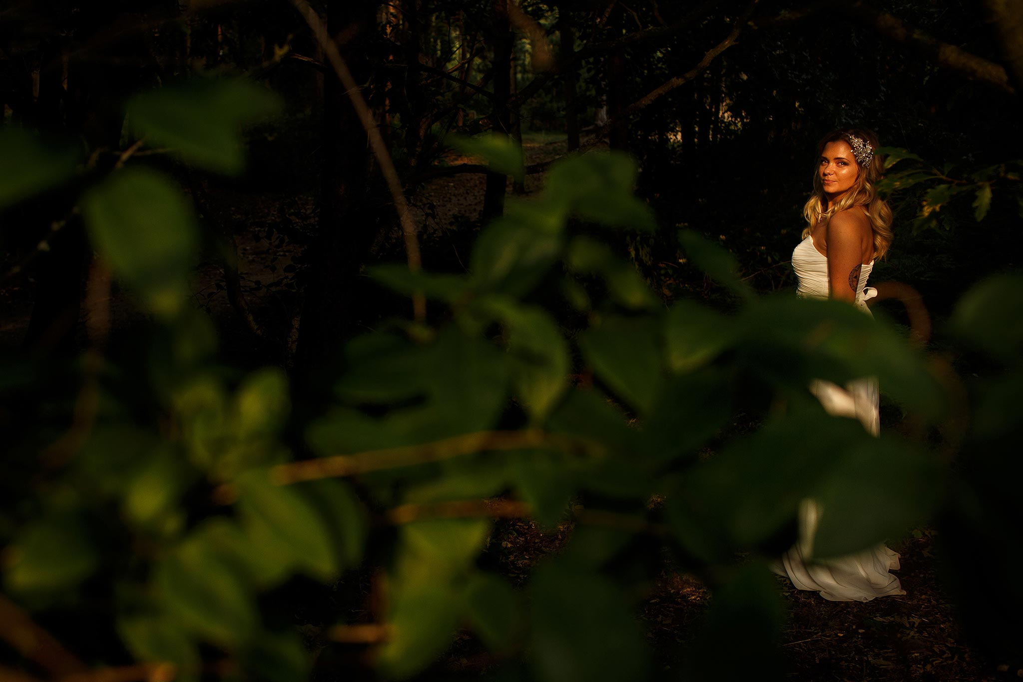 Creative photograph of a bride in the woodland