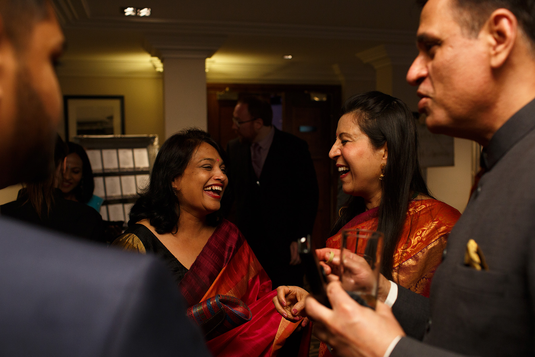 Guests laughing at Indian Wedding Reception