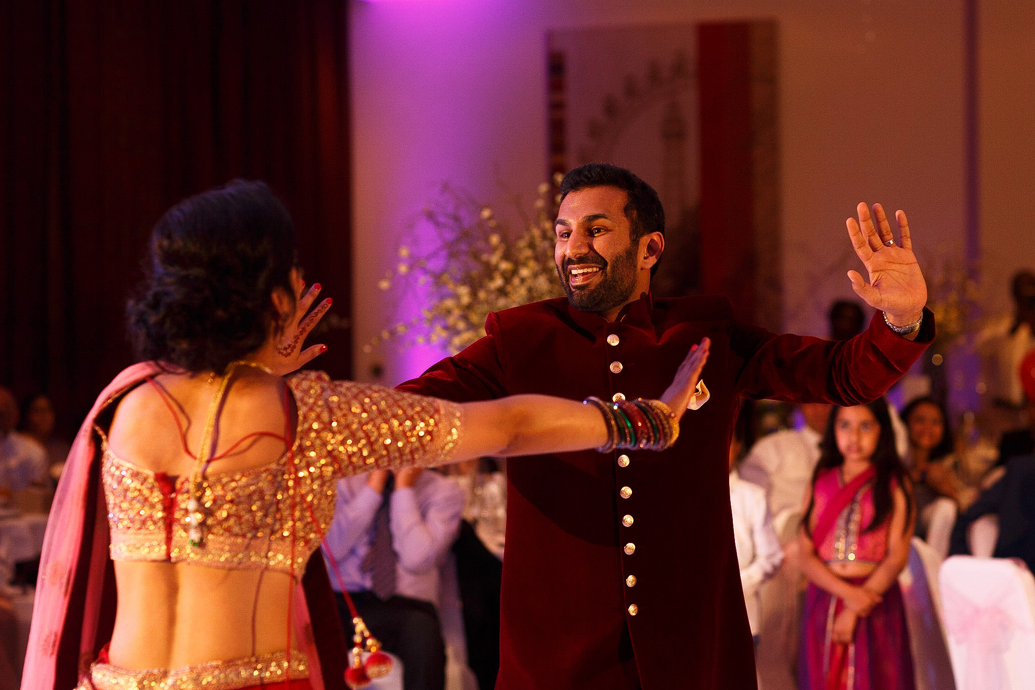 Bride and groom dancing together at their Indian wedding reception