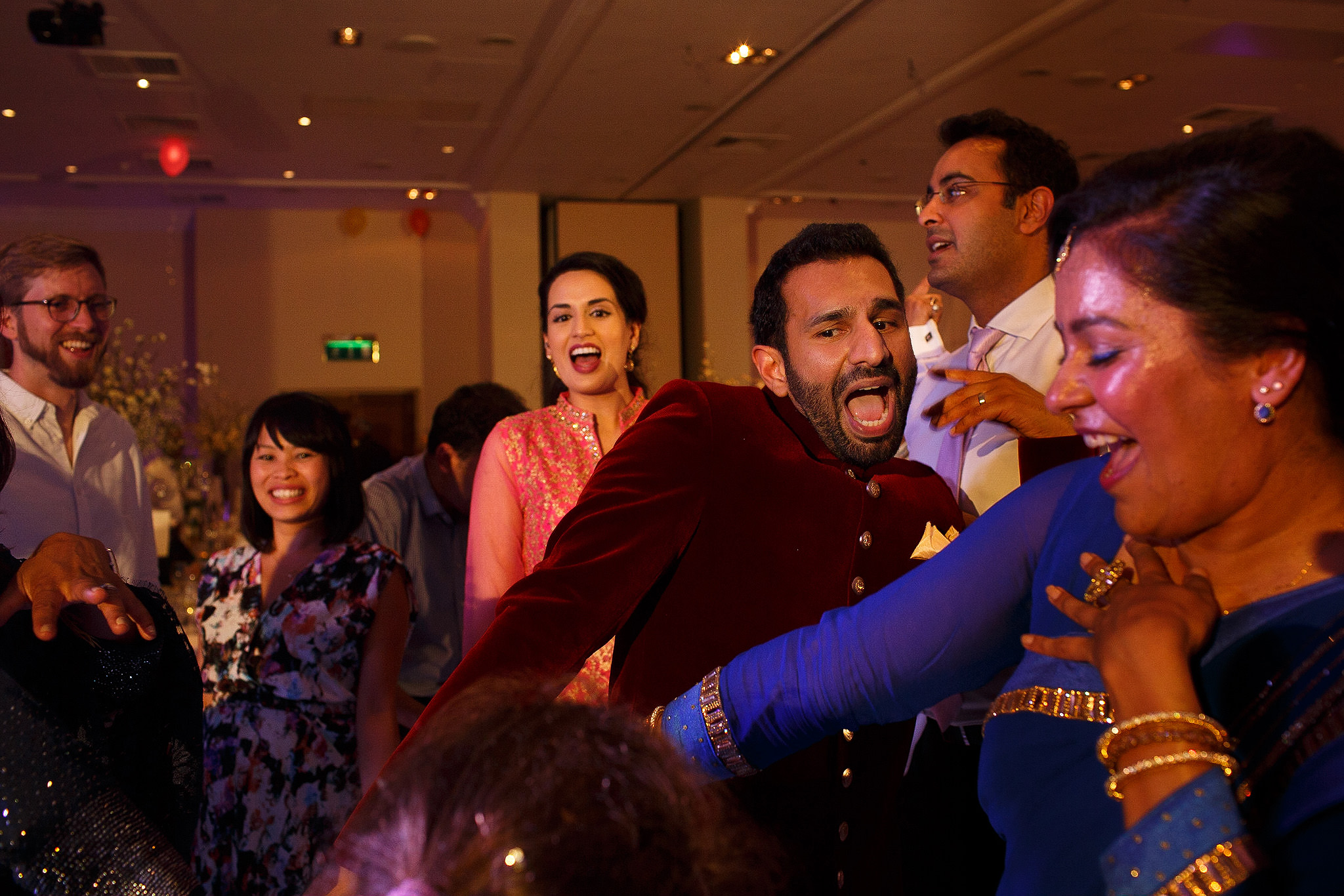 Guests dancing at Indian wedding reception