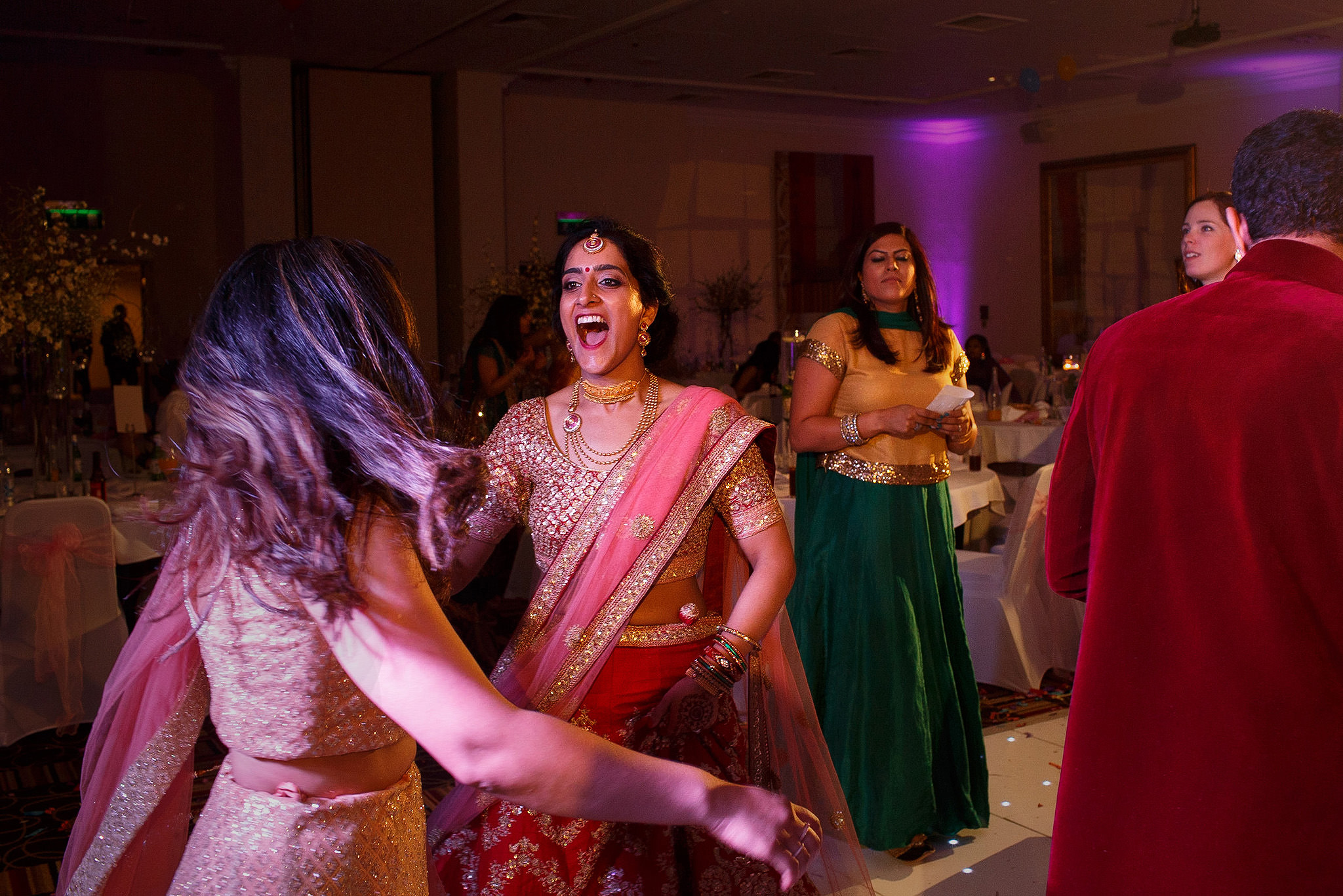 Bride dancing at Indian wedding reception