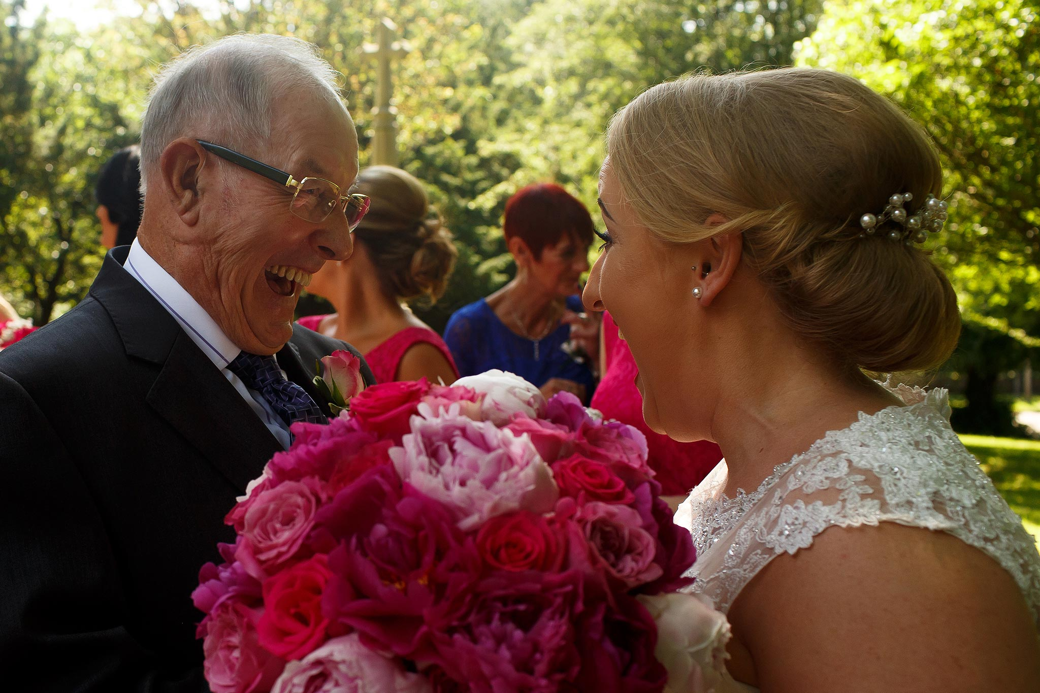 Guest congratulating newlywed bride outside church