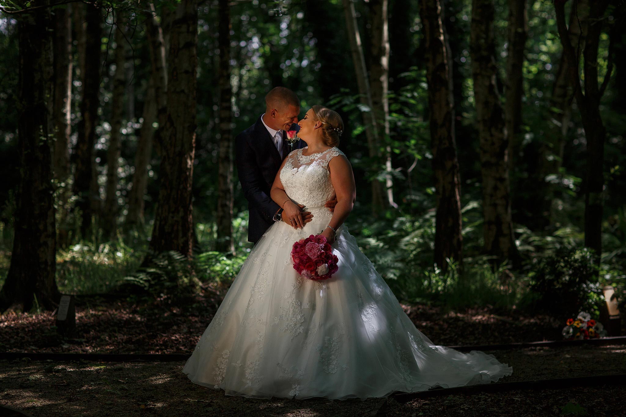 Full length image of bride and groom in woodland