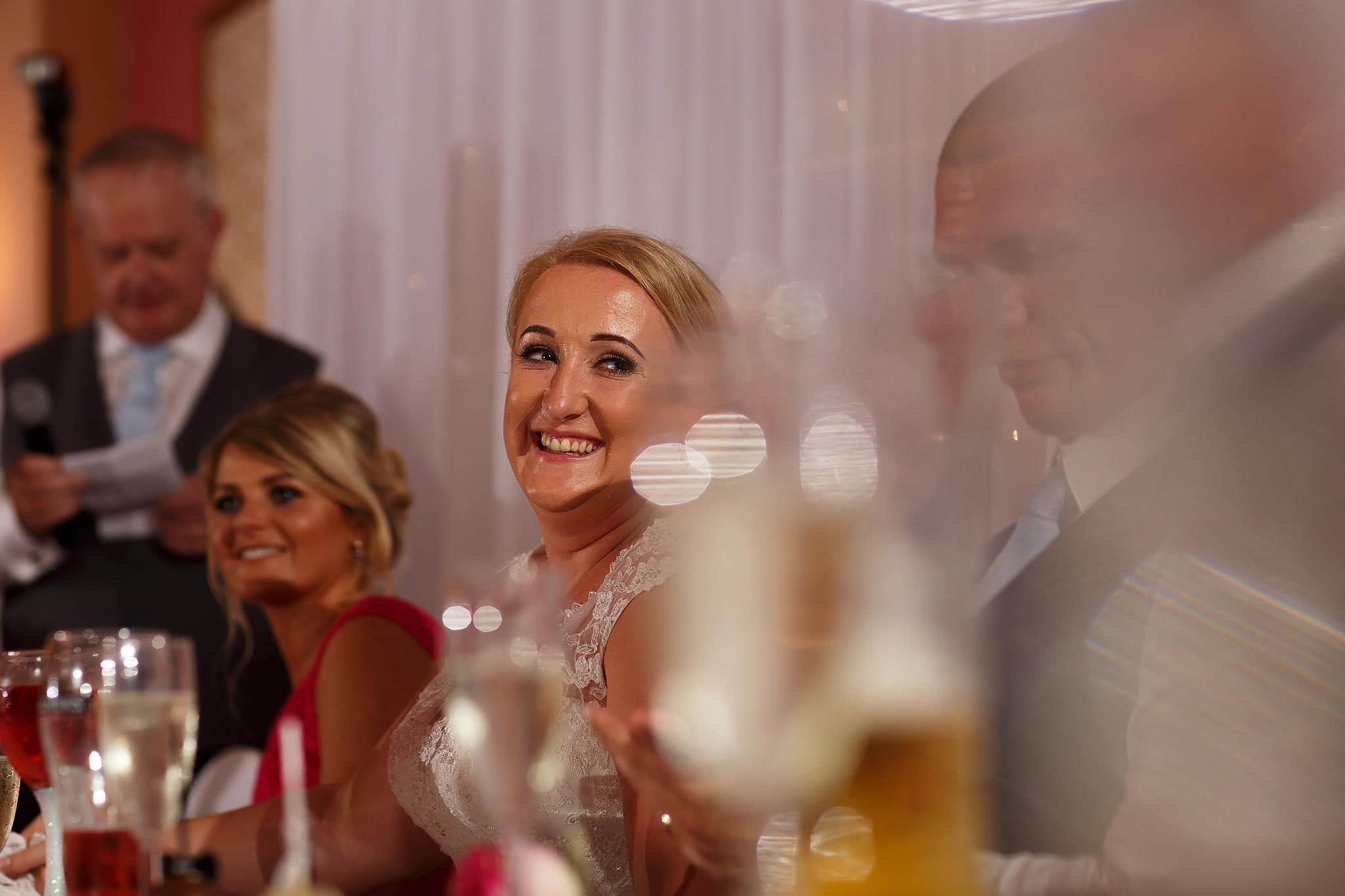 Bride laughing during speeches at Swinton Masonic Hall