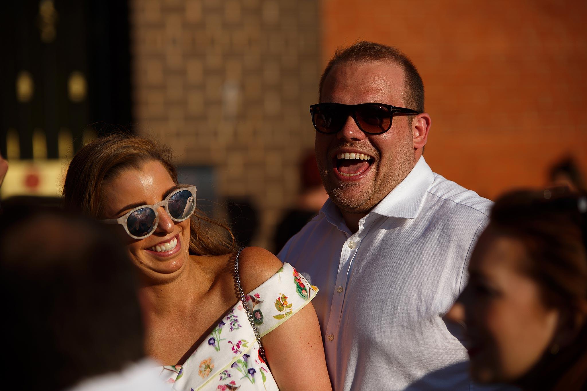 Guest laughing outside Swinton Masonic Hall wedding