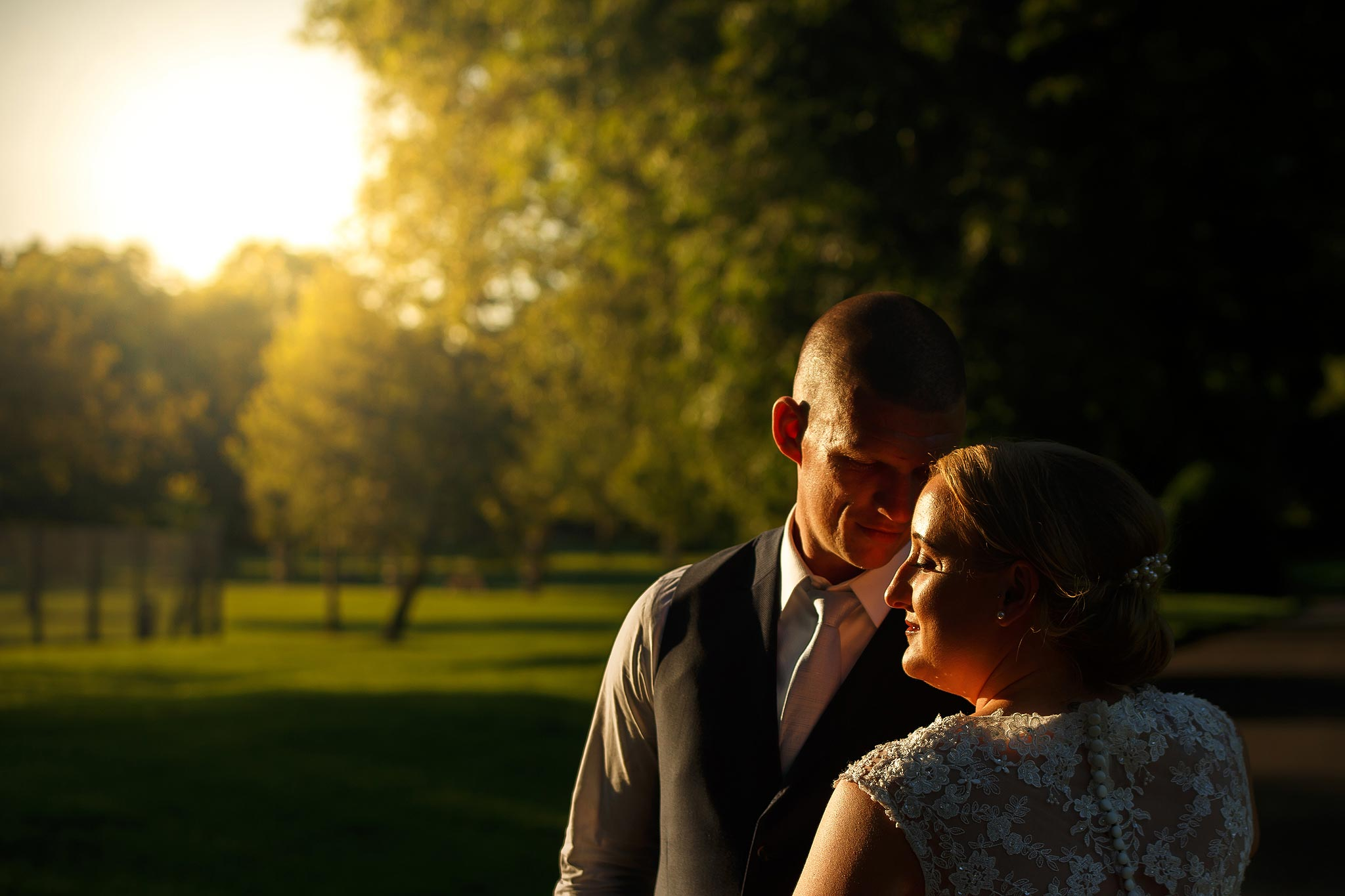 Bride and groom dancing in the sunset at golden hour