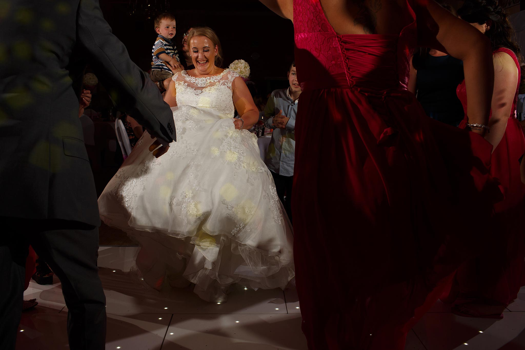 Bride dancing on their wedding day at Swinton Masonic Hall