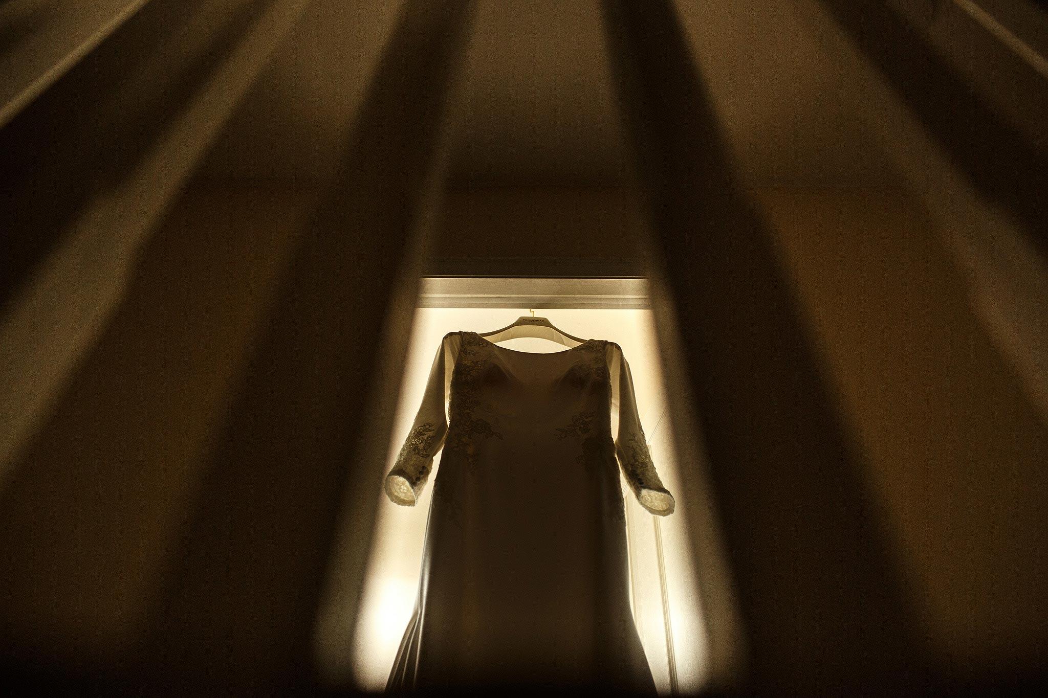 brides wedding dress through a staircase