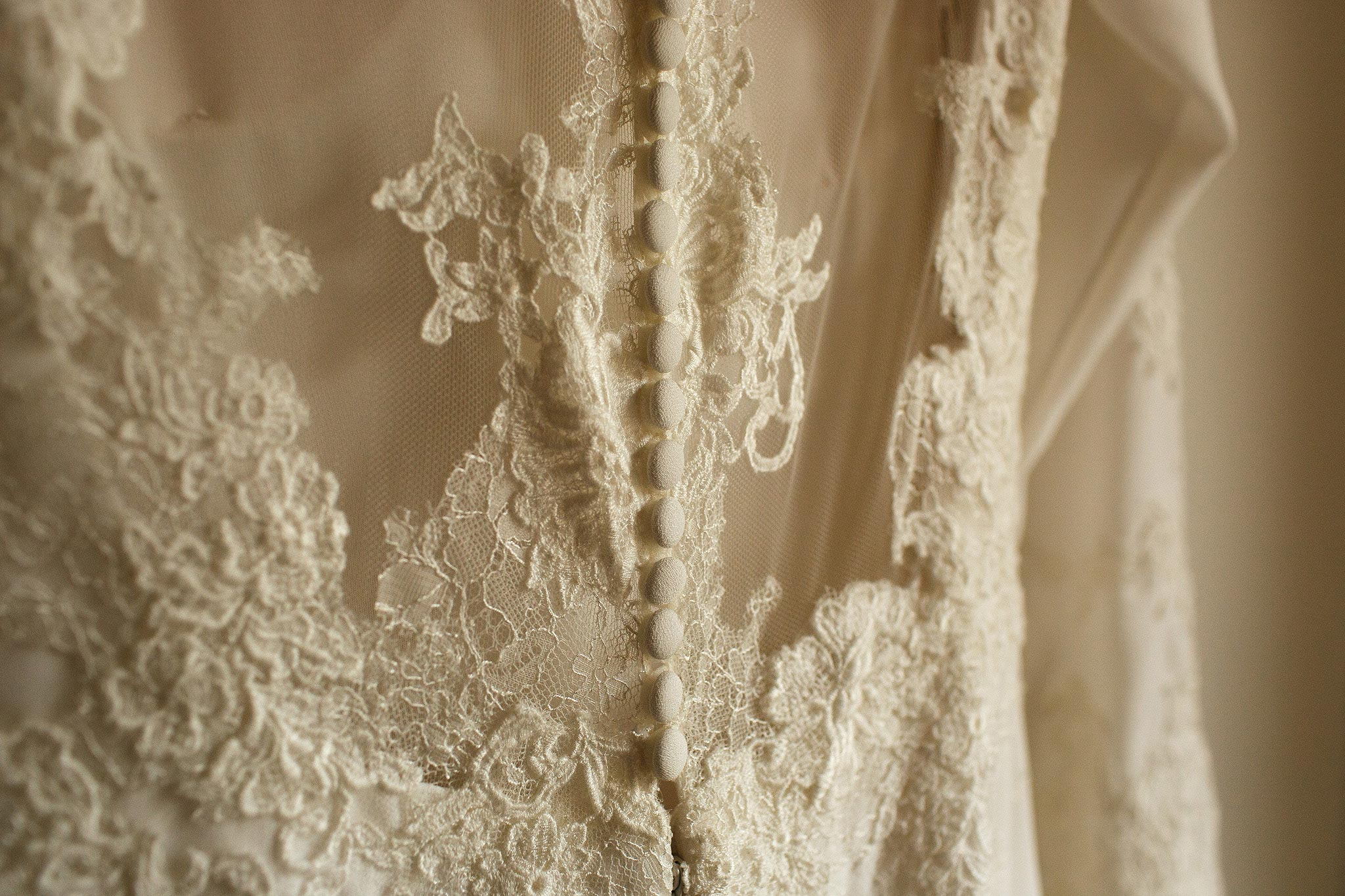 detailed picture of a brides wedding dress