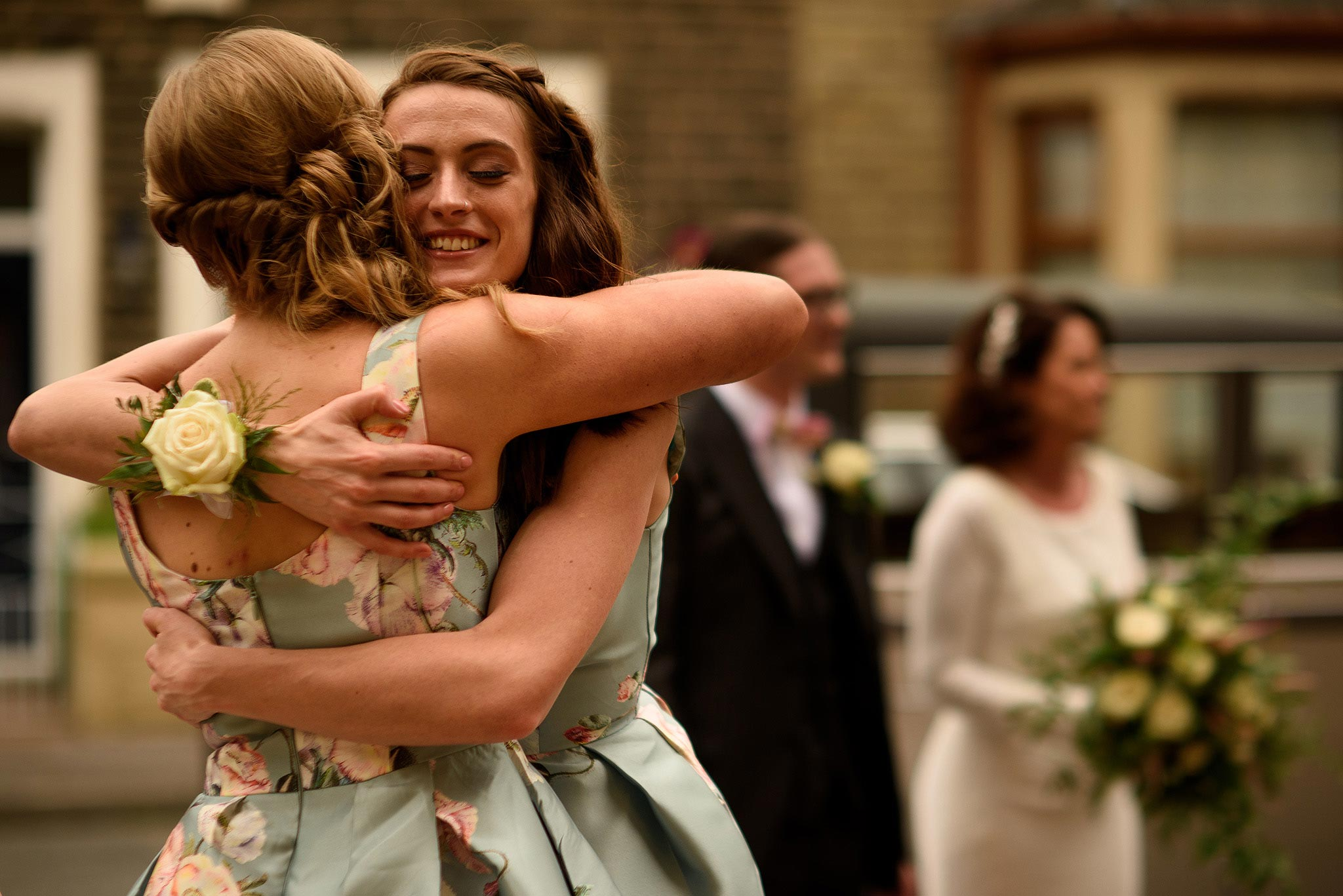 bridesmaids embracing outside church
