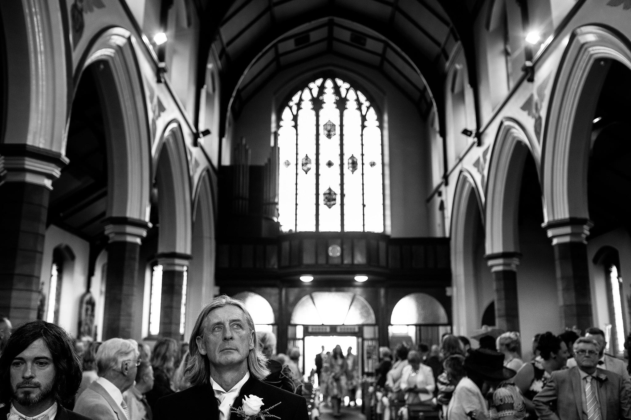 nervous groom waiting at the top of the aisle