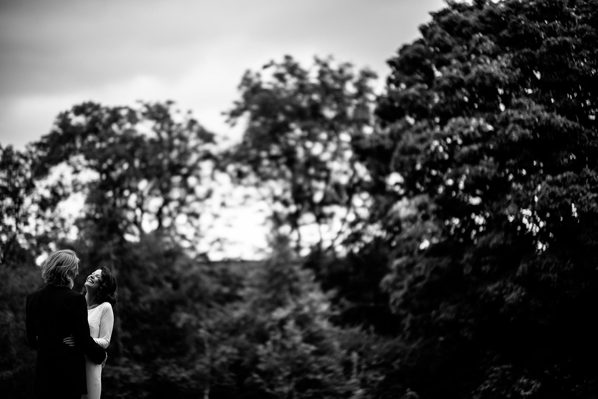 Bride and groom in the gardens of the Stirk House Hotel with the Ribble Valley in the background