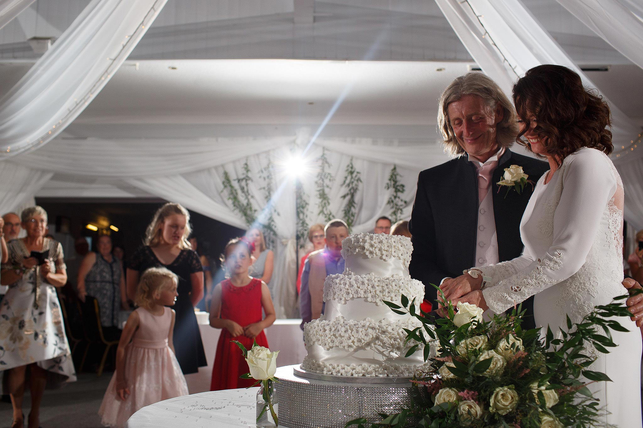 Bride and groom cutting the cake at Stirk House hotel wedding reception