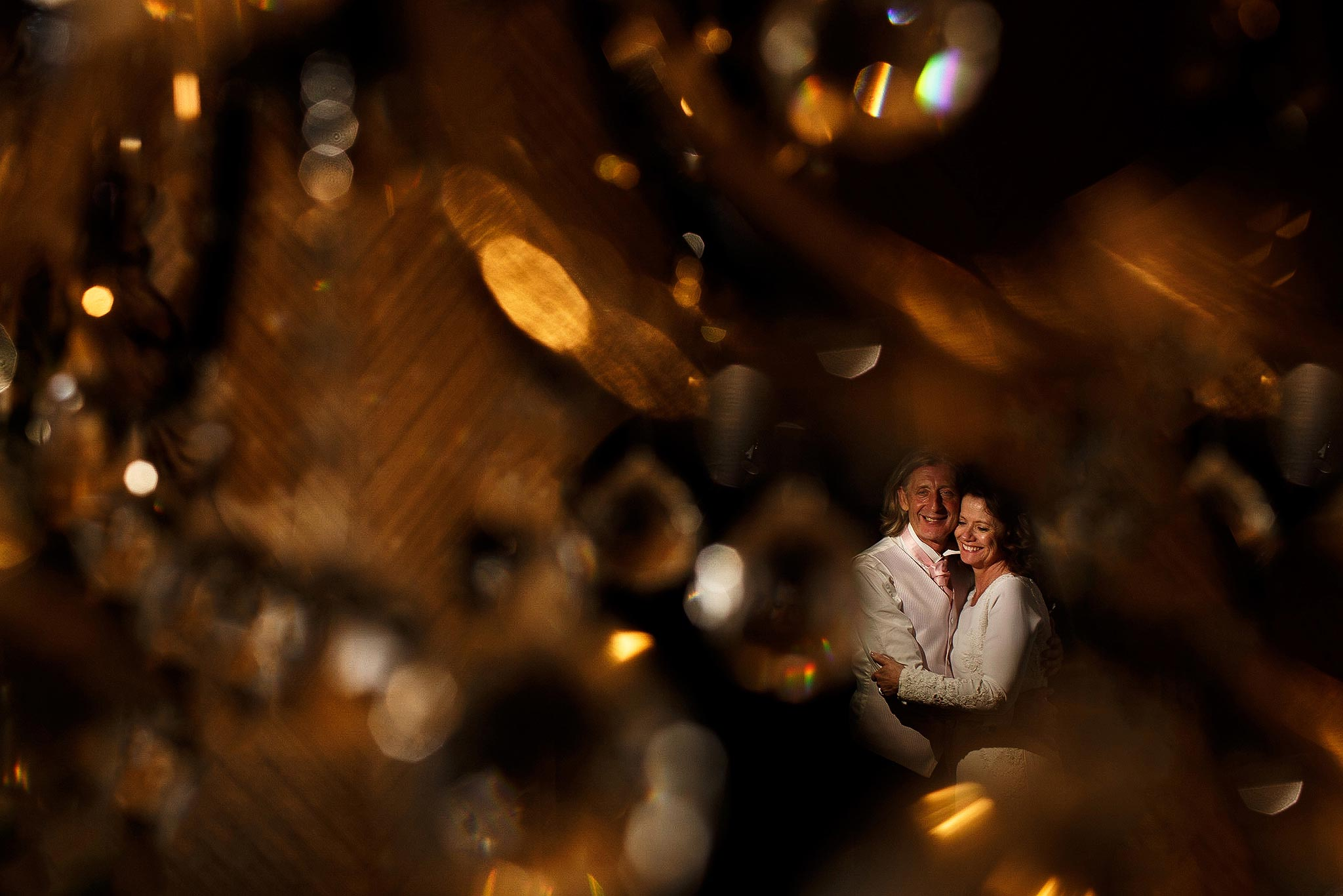 Creative evening wedding portrait of bride and groom at Stirk House Hotel in Lancashire using crystals and mag mod flash modifiers