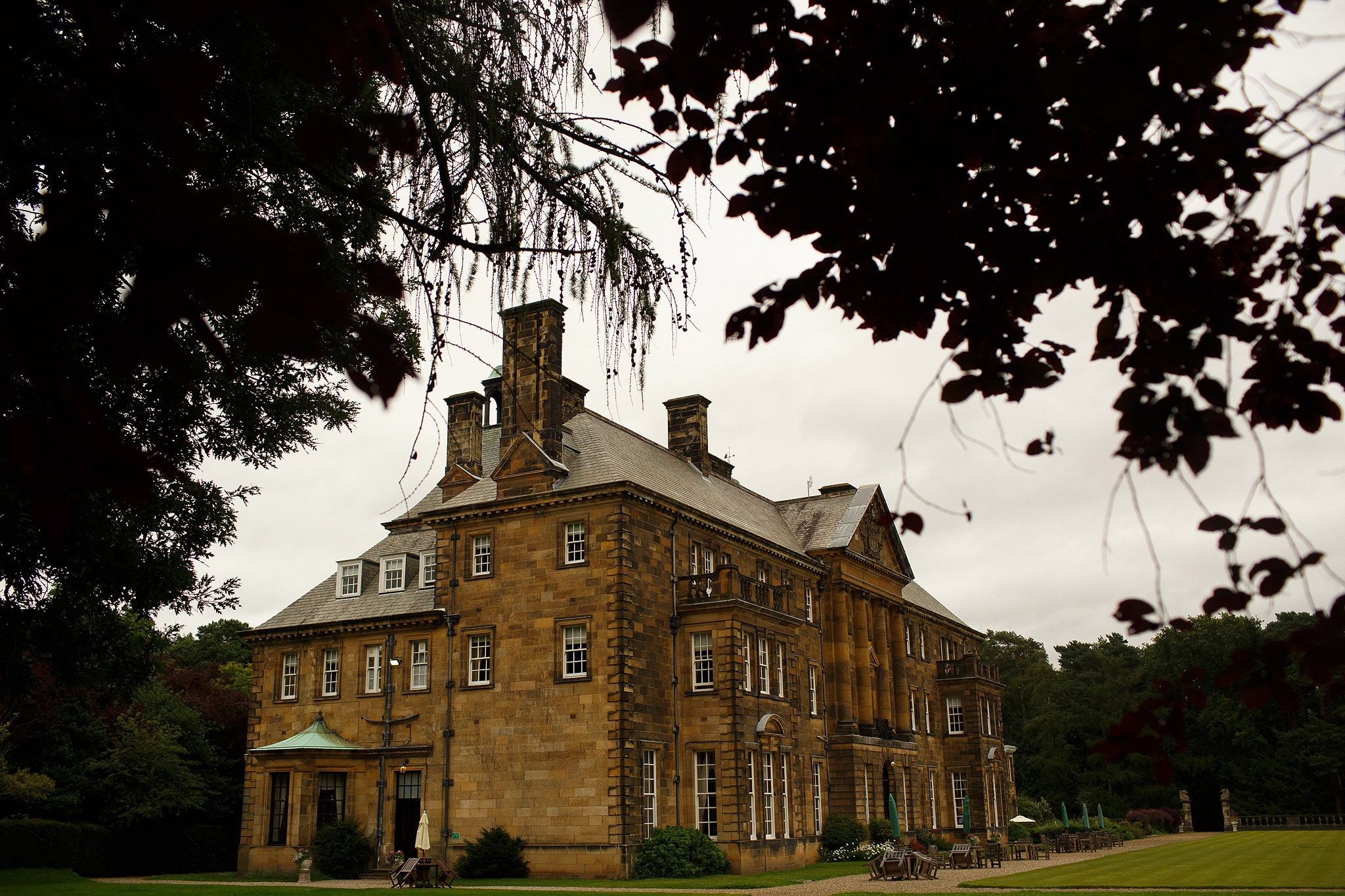 wide view of crathorne hall from gardens