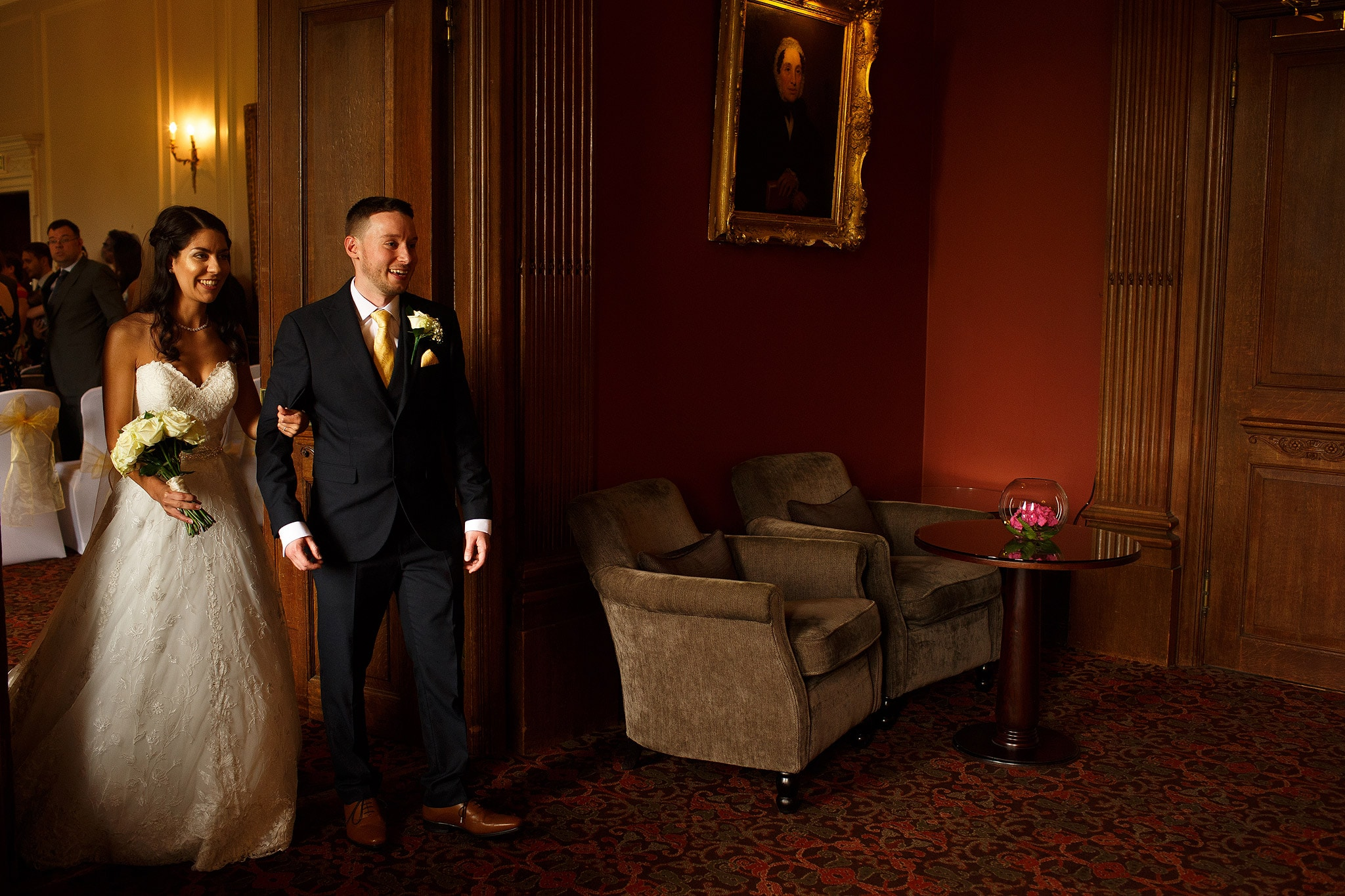Bride and Groom entering wedding reception inside Crathorne Hall