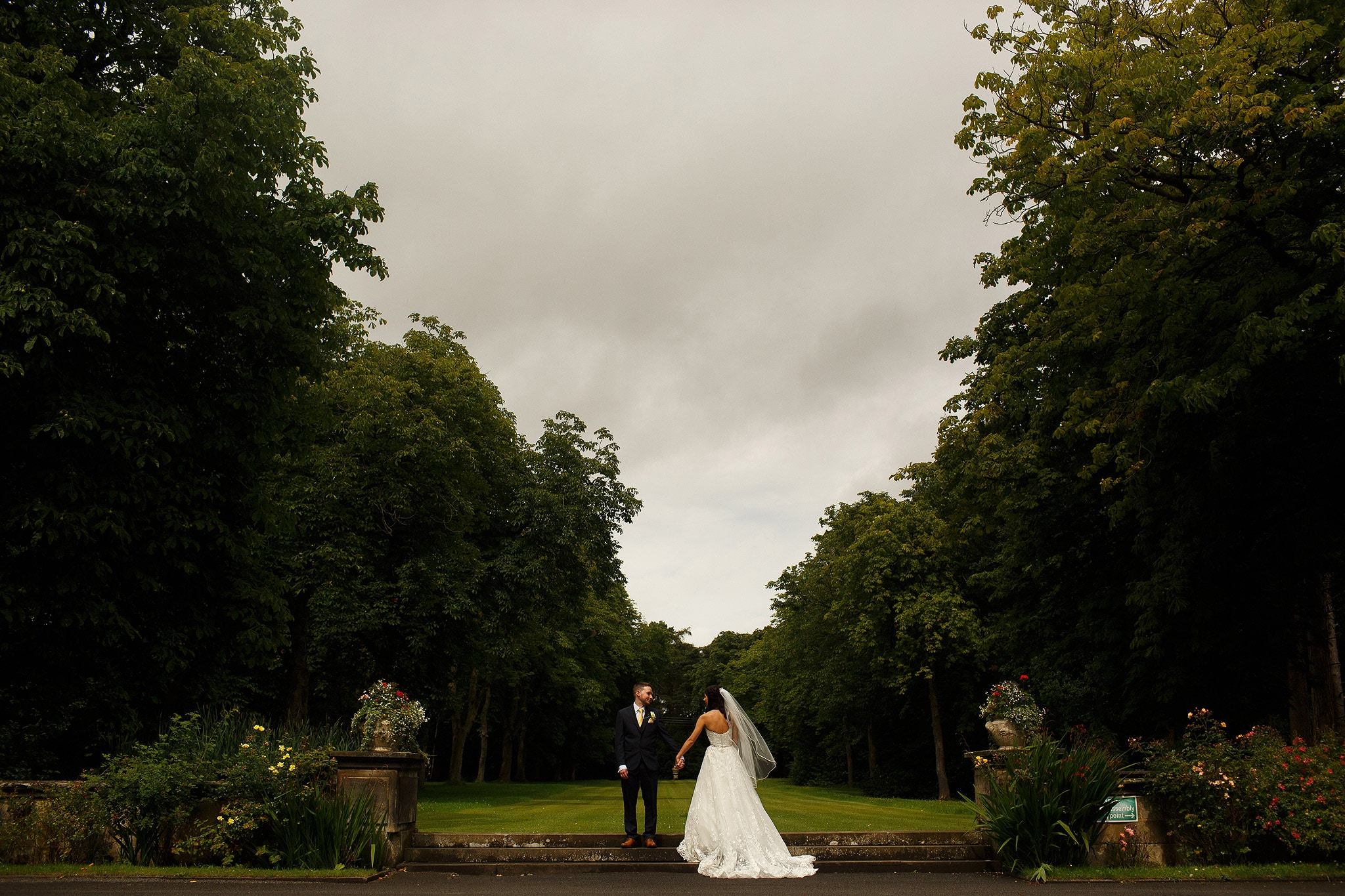 wedding portrait of bride and groom in the gardens at Crathorne Hall