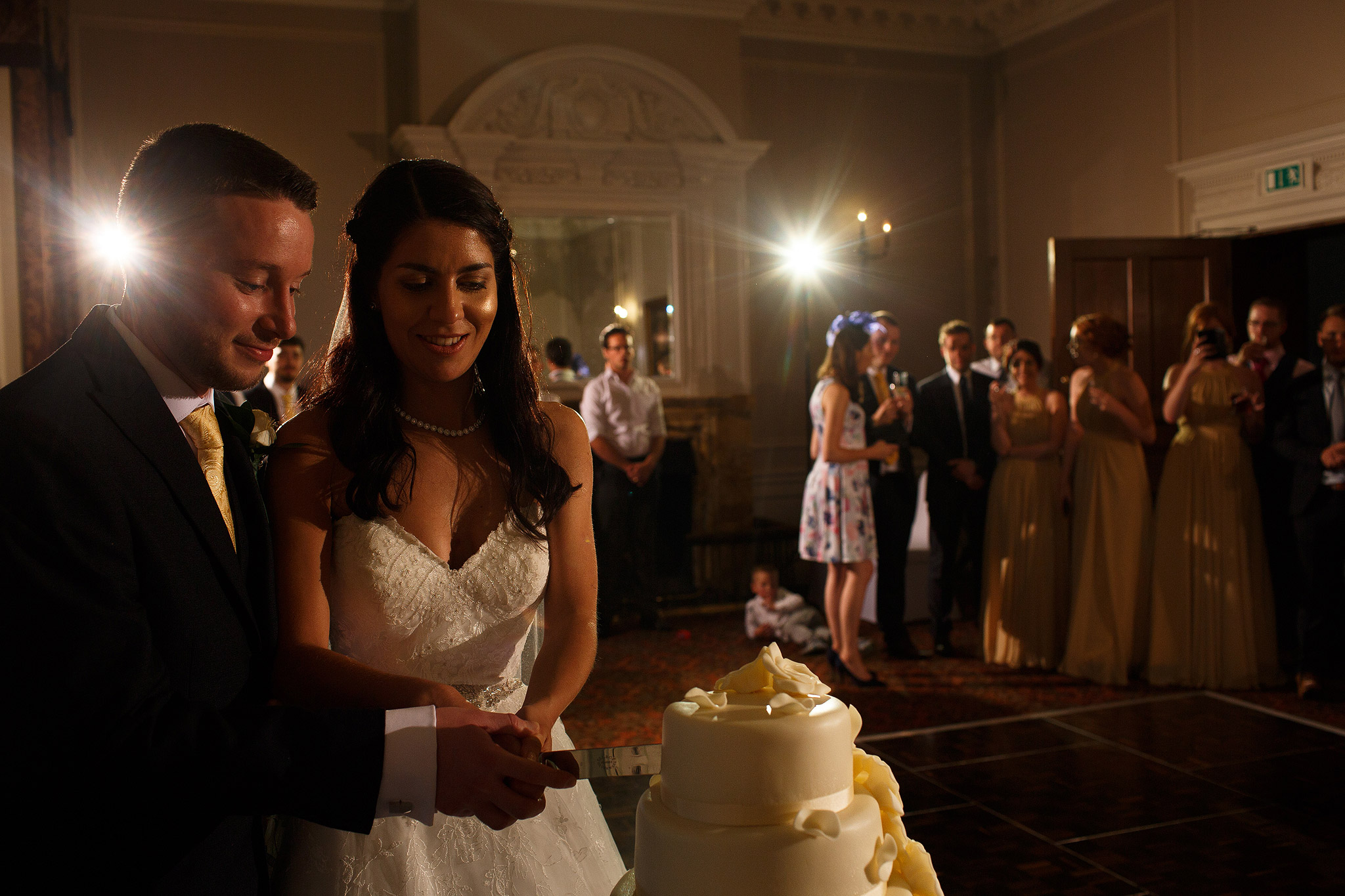 Bride and groom cutting the cake at Crathorne Hall wedding