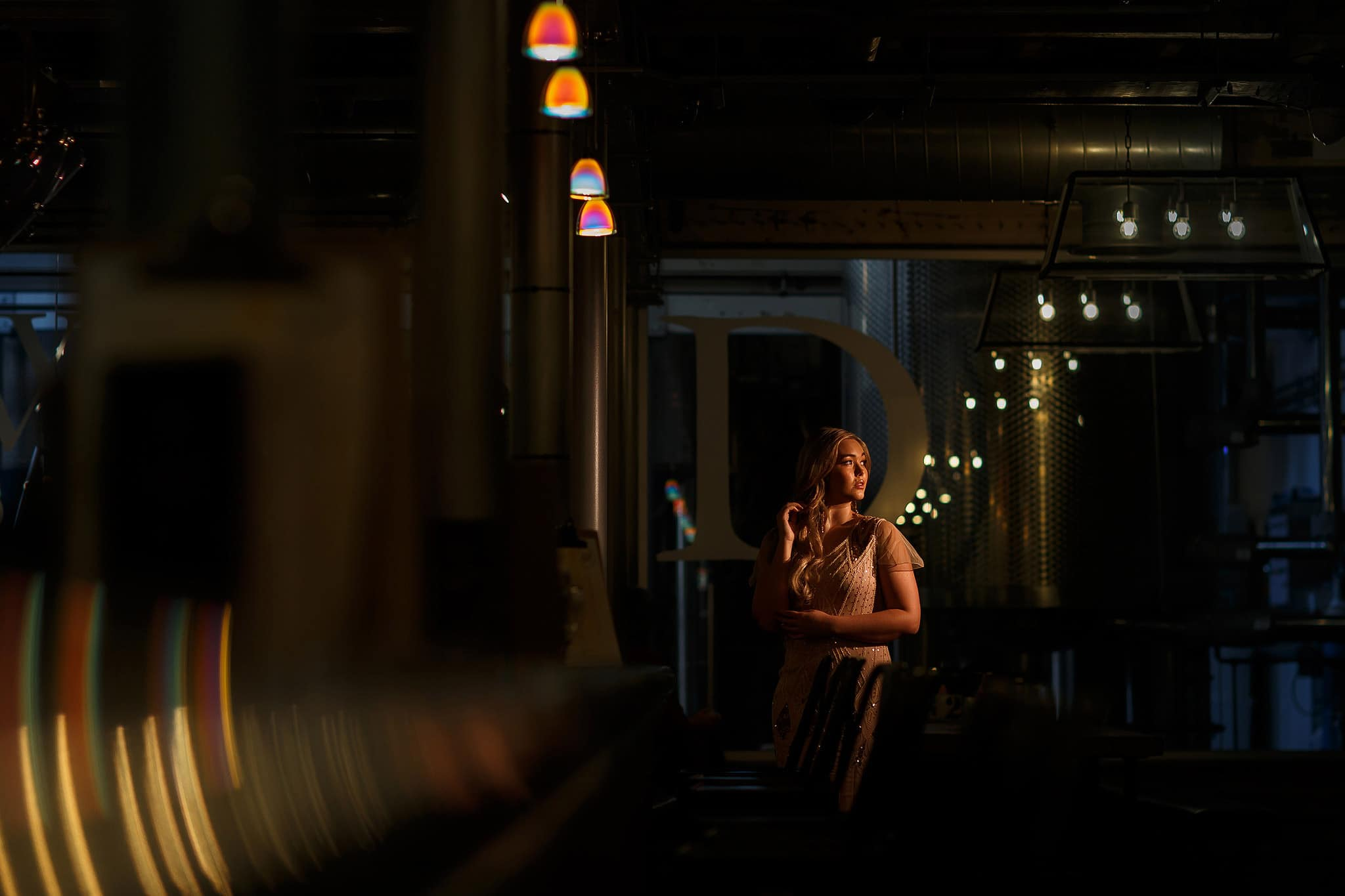 creative portrait of bride wearing beaded dress at holmes mill longest bar