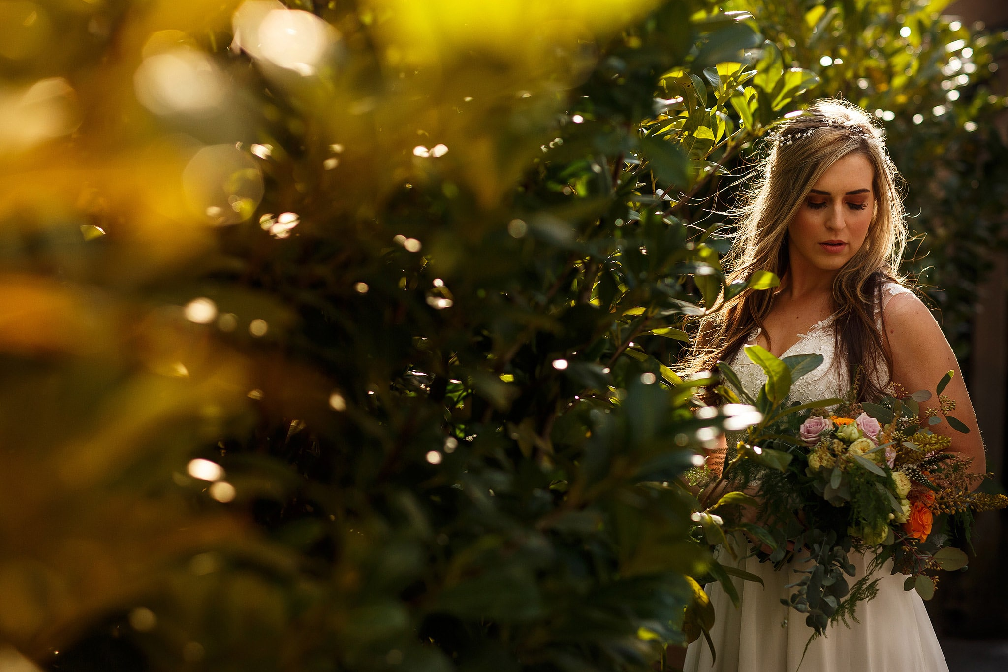 creative portrait of bride backlight by sunshine outside holmes mill