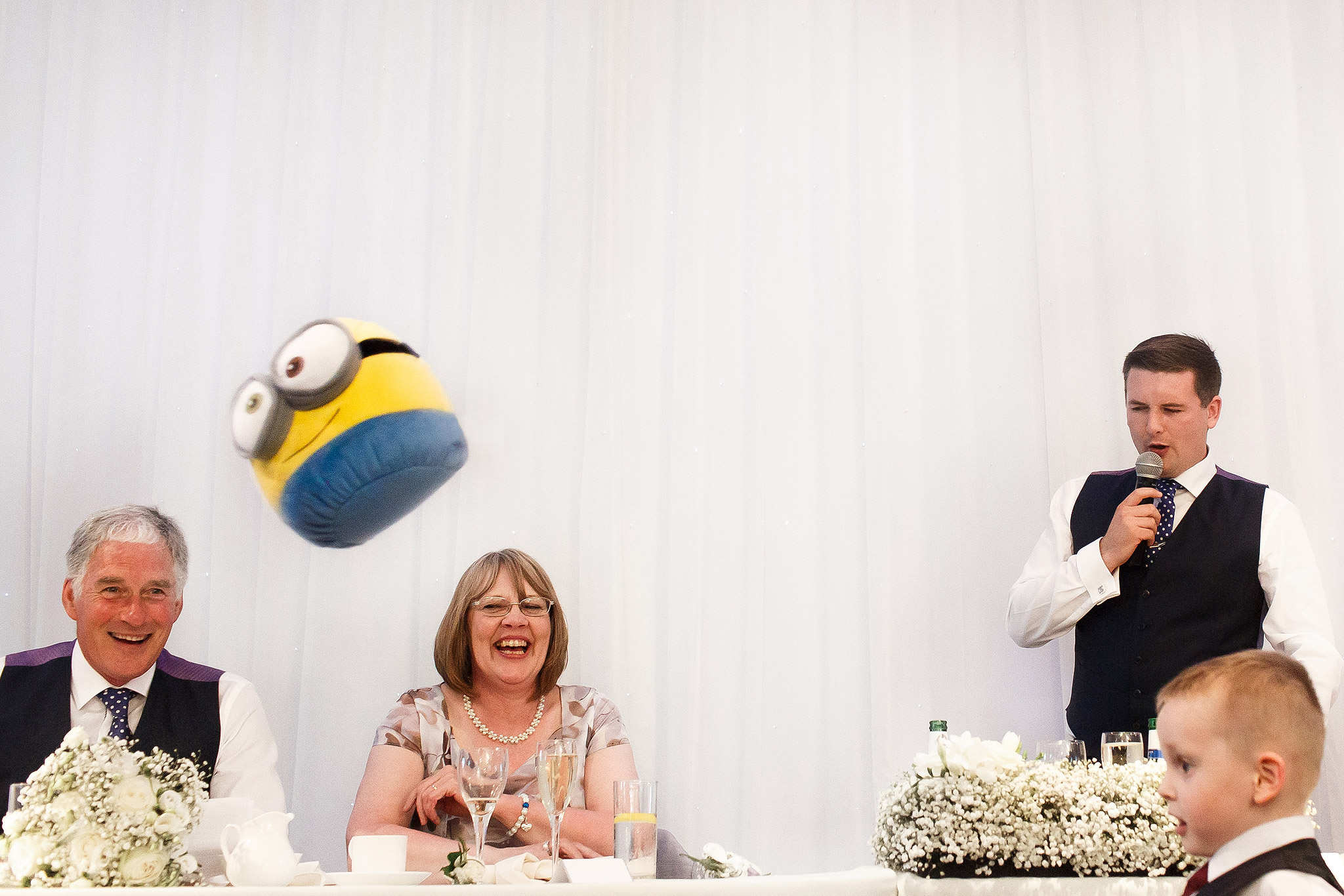 minion cuddly toy being thrown during wedding speeches