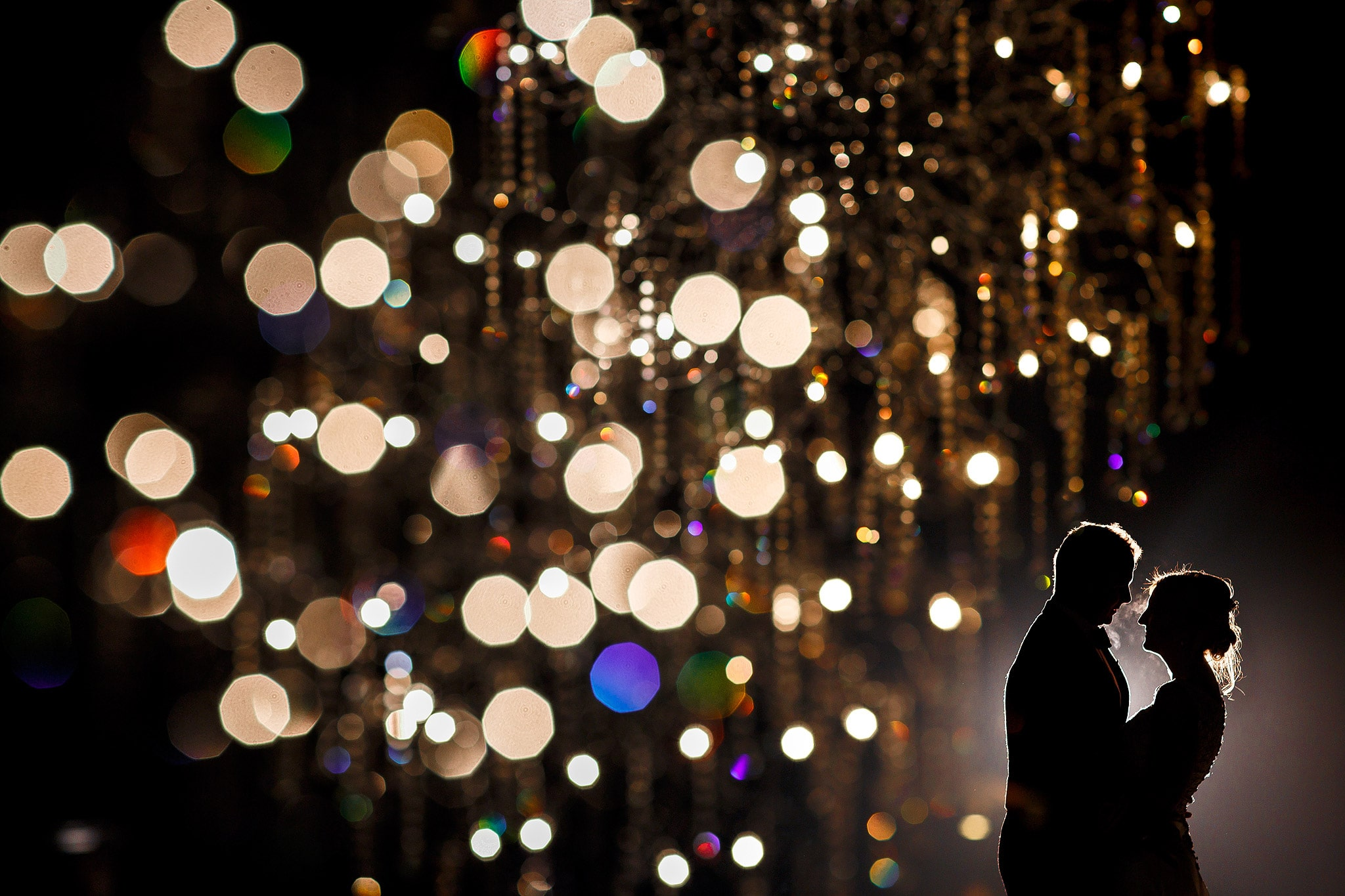 creative wedding portrait of bride and groom using lights at mitton hall