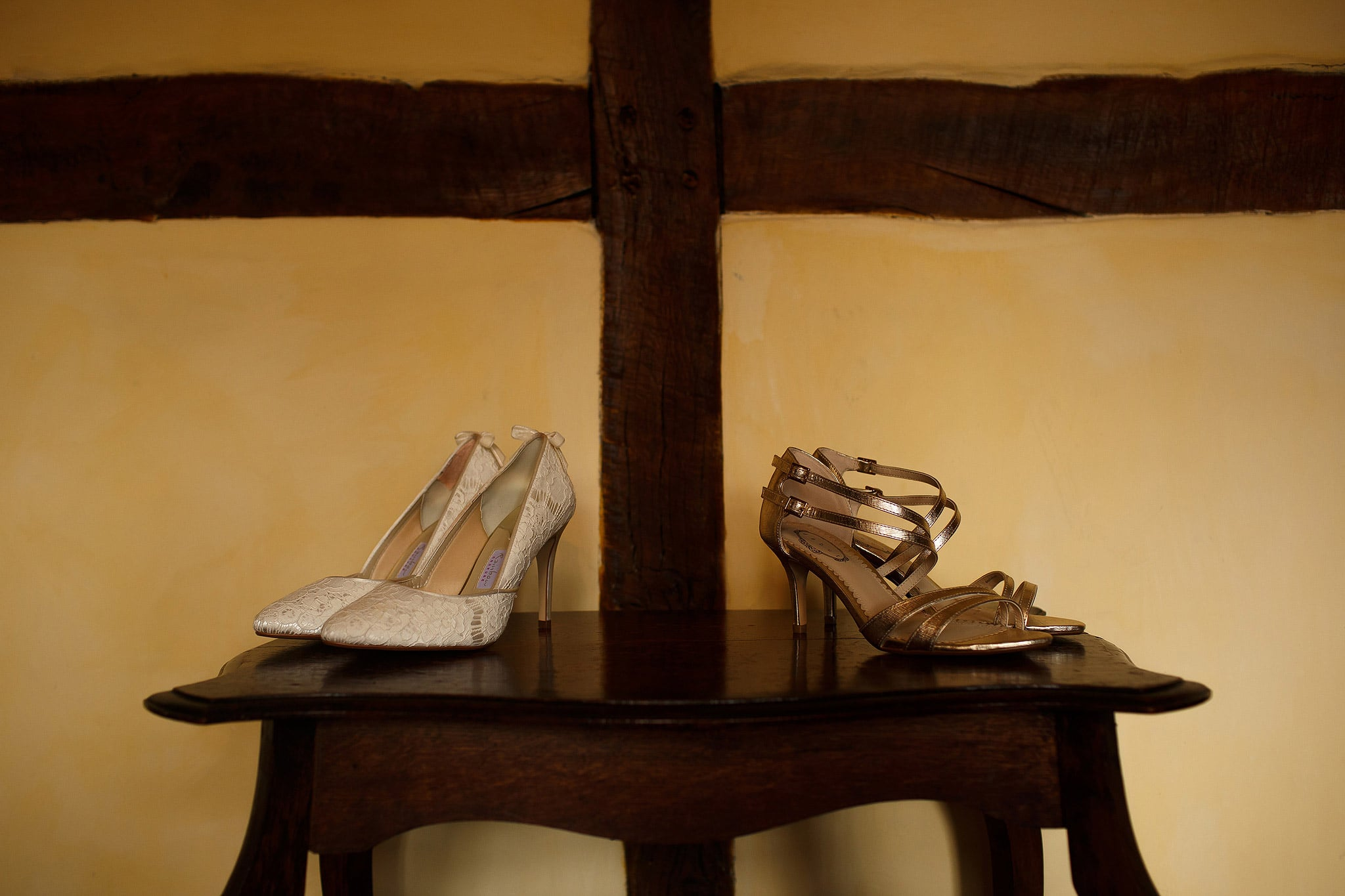 Two pairs of brides shoes on the table - great hall at mains wedding photography