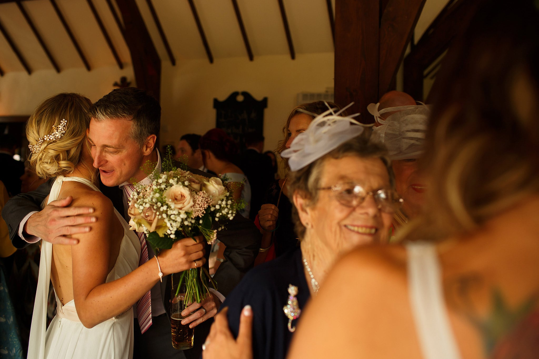 Family congratulating the newly wed brides after wedding ceremony - great hall at mains wedding photography