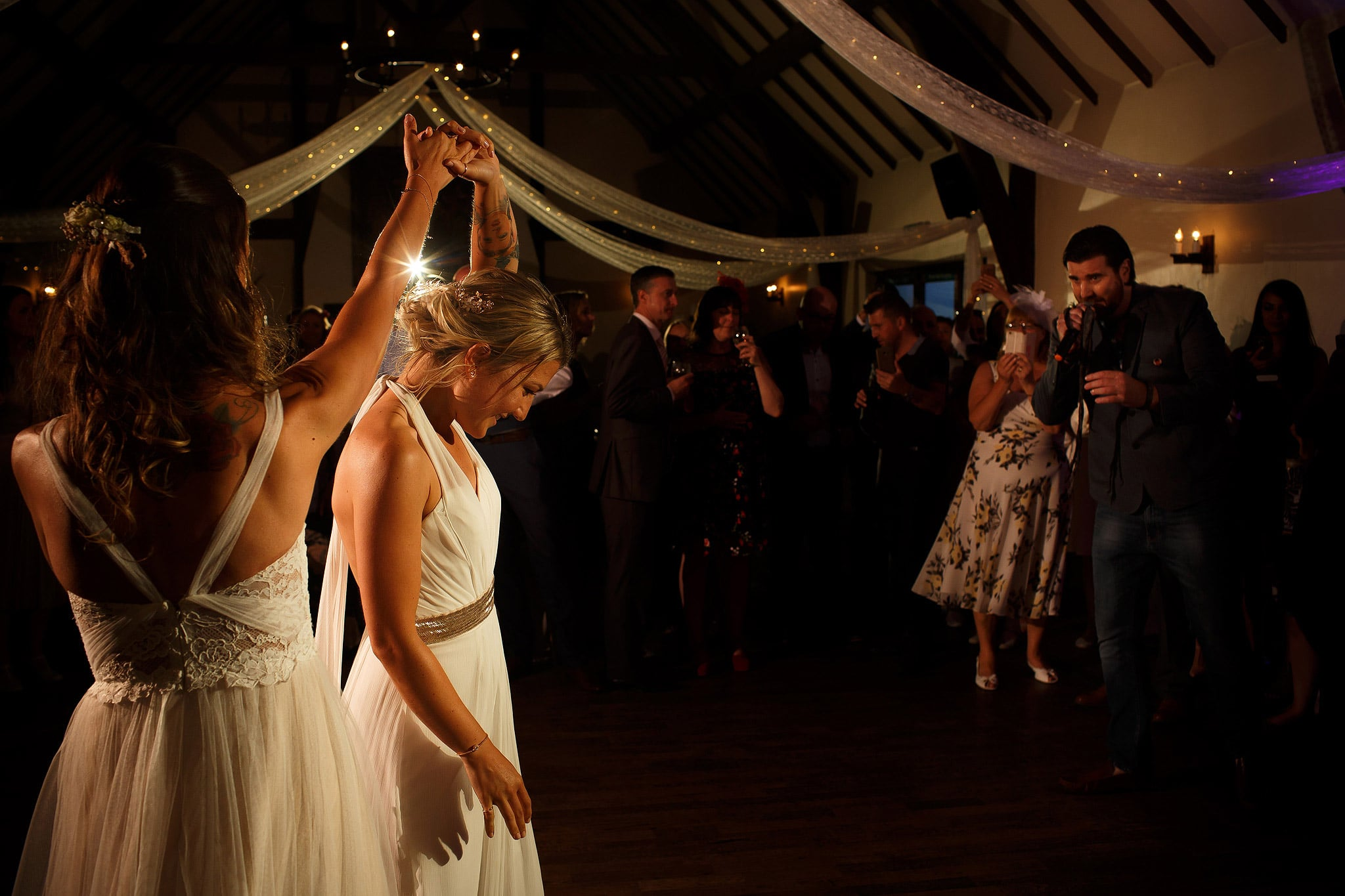 Brides twirling round the dance floor at great hall at mains wedding