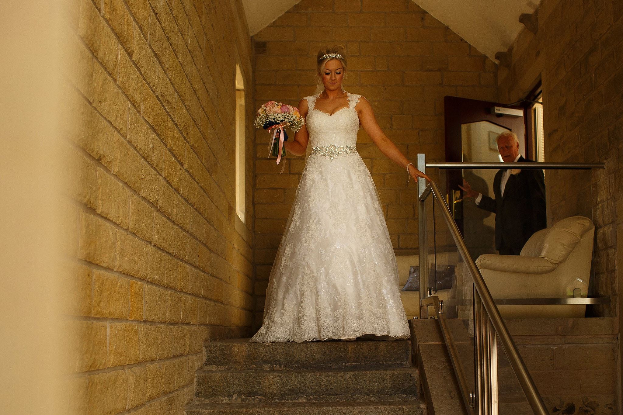 bride walking down the steps at Saddleworth Hotel
