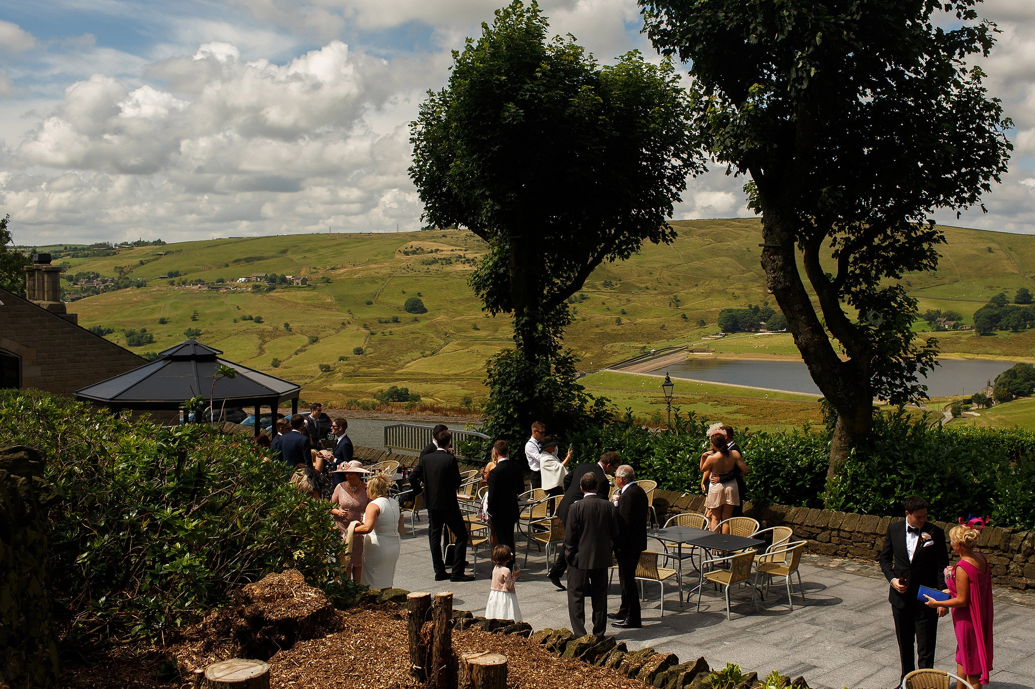 Wedding guests enjoying the sunshine outside Saddleworth Hotel