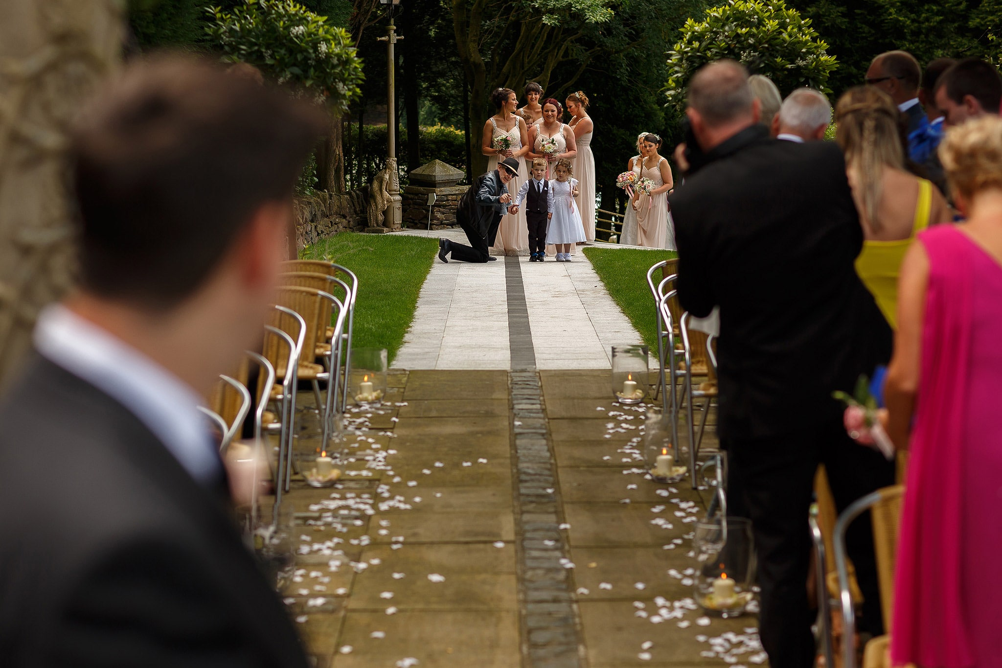 Bridal party walking down the aisle for outdoor wedding at Saddleworth Hotel